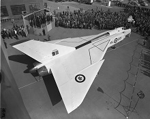 A view of the Avro CF-105 Arrow, showing its distinctive delta wings, during unveiling ceremonies at Avro Aircraft Limited in Malton, Ontario, on October 4, 1957. PHOTO: DND Archives, PL-107092