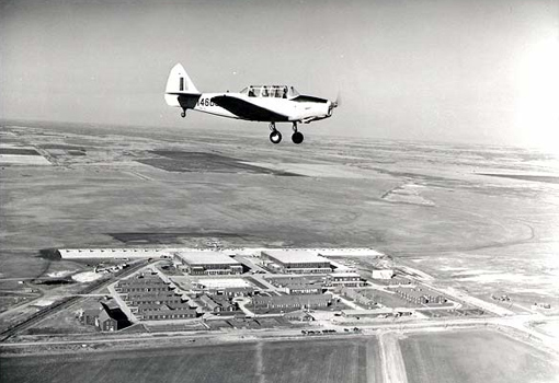 A Fairchild Cornell overflies No. 19 Elementary Flying Training School at RCAF Virden in Manitoba in October 1944. PHOTO: Nicholas Morant, DND Archives,