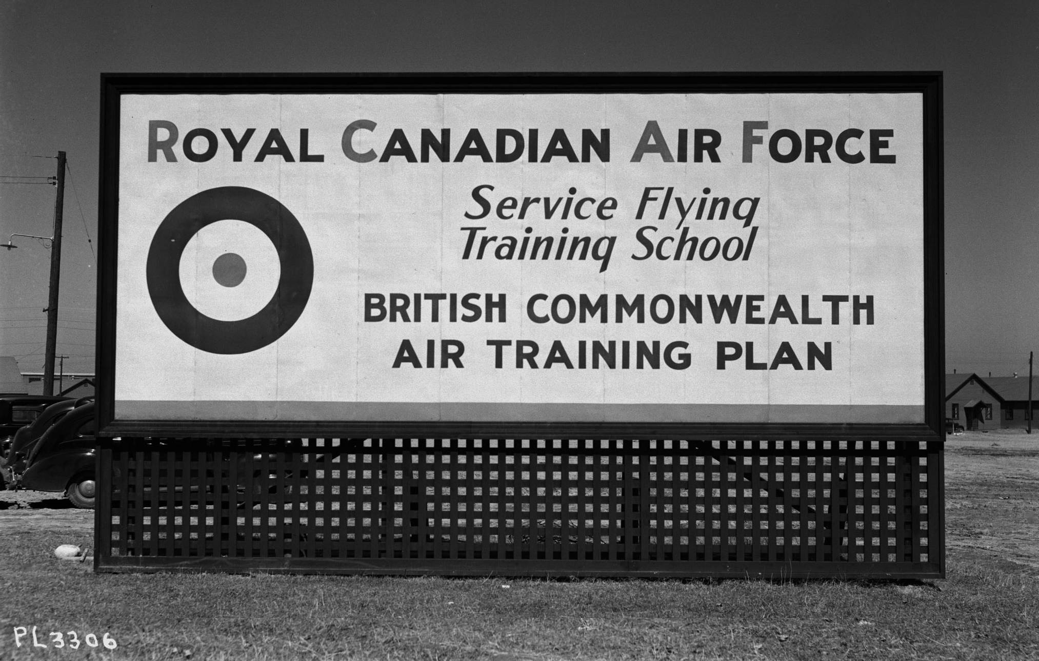 Signs such as this became part A large white sign with black lettering and an Air Force roundel in the corner.of the Canadian landscape as schools and airfields opened throughout the nation under the British Commonwealth Air Training Plan.