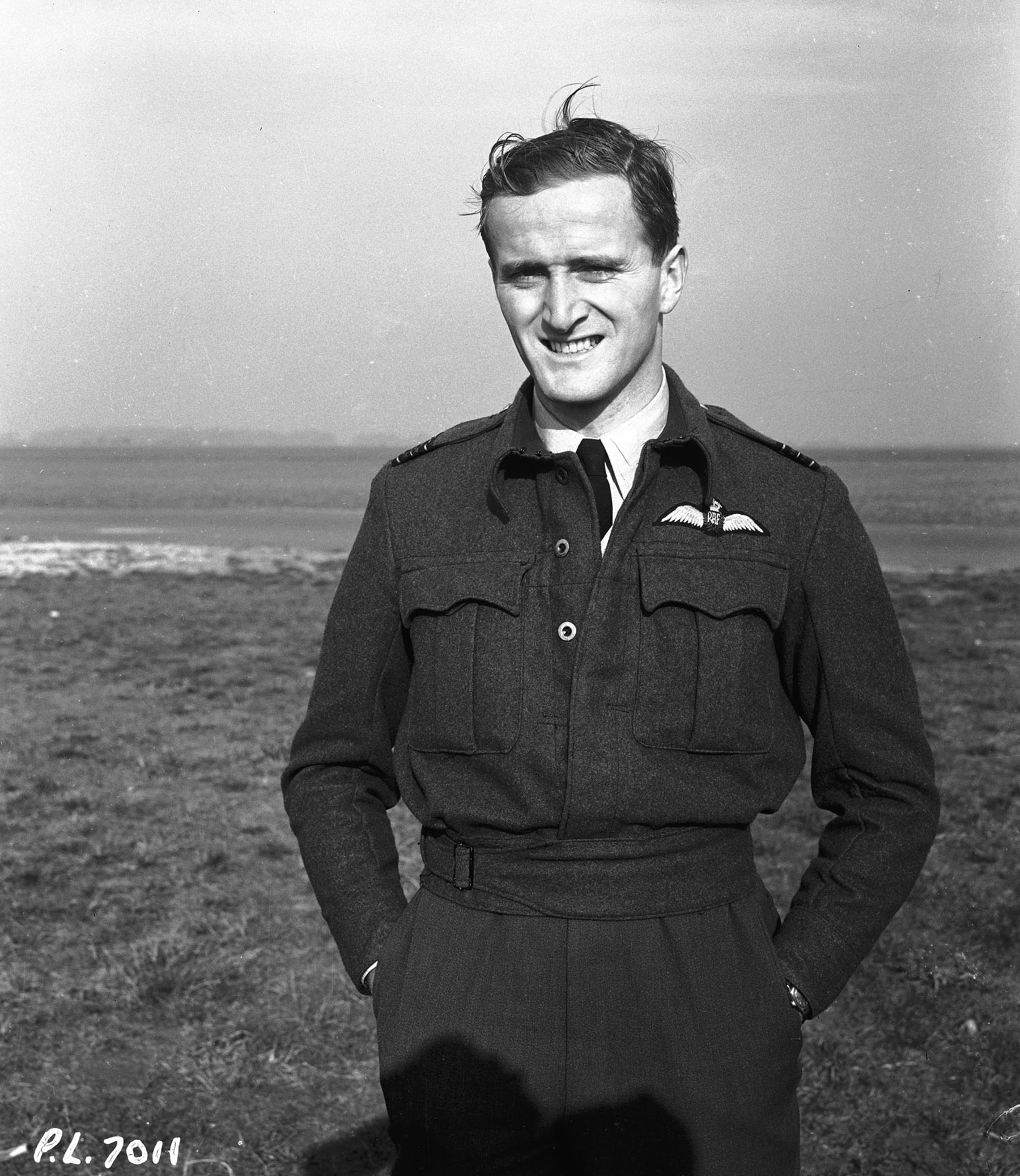 Squadron Leader Paul Brooks Pitcher, from Montreal, Quebec, a Royal Canadian Air Force pilot and veteran of the Battle of Britain, is photographed on November 5, 1941, on a break from commanding a Canadian fighter squadron in England.
