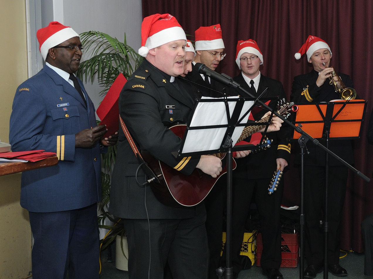 Music and song is always a part of Christmas celebrations. Here, Canadian Armed Forces chaplains serenade guests at the annual junior ranks Christmas dinner at 12 Wing Shearwater on December 12, 2013. PHOTO: Master Corporal Maggie Gosse