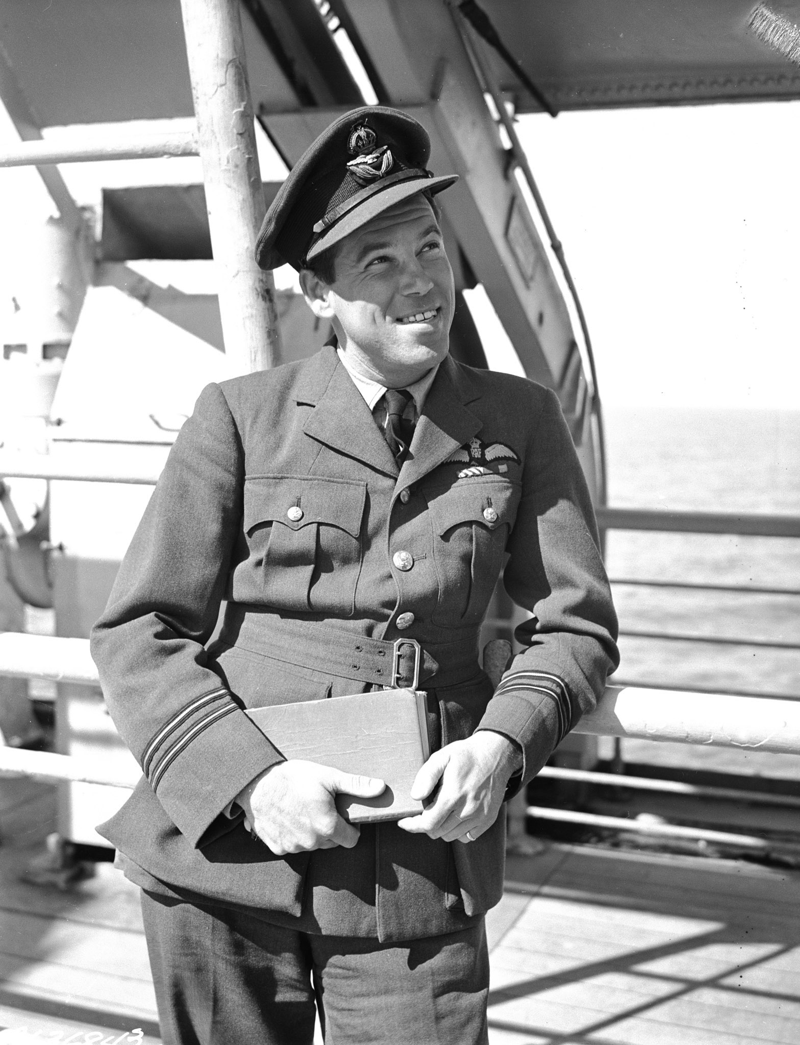 A black and white photo of a Second World War air force officer in dress uniform, wearing a hat.