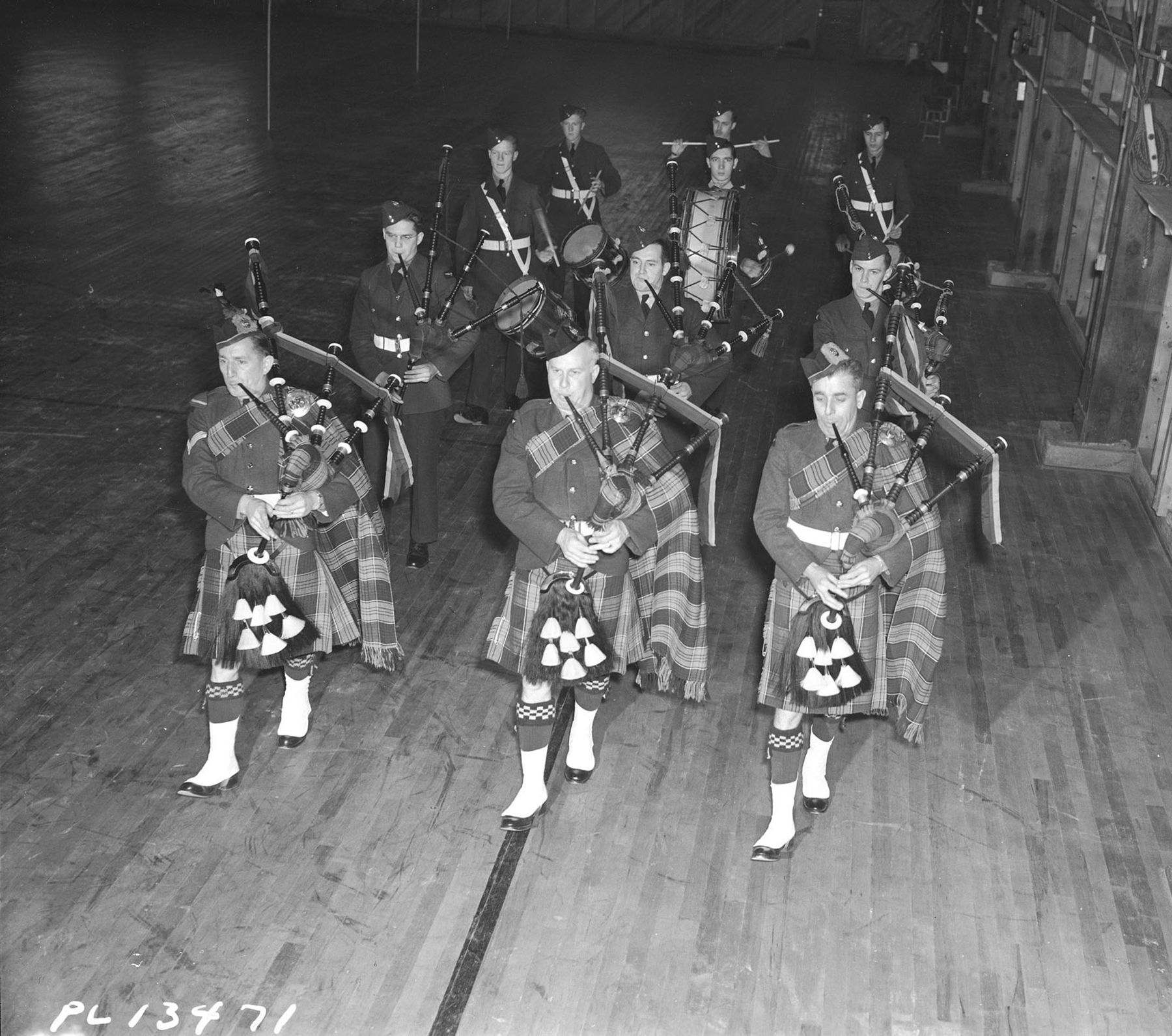 Members of the No. 9 Service Flying Training School Pipe Band in Centralia, Ontario, parade in full regalia on February 24, 1943. PHOTO: DND Archives, PL-13471