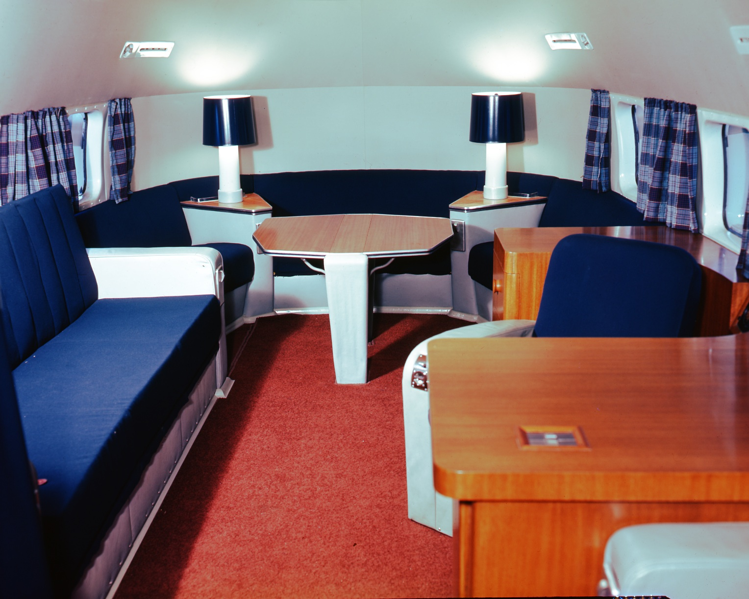 This aft cabin of a North Star conversion done by Canadair and delivered to Ottawa as the Royal Canadian Air Force's premier VIP aircraft is decorated with typical 1950s-style furnishings and Royal Canadian Air Force tartan curtains. PHOTO: Canadair
