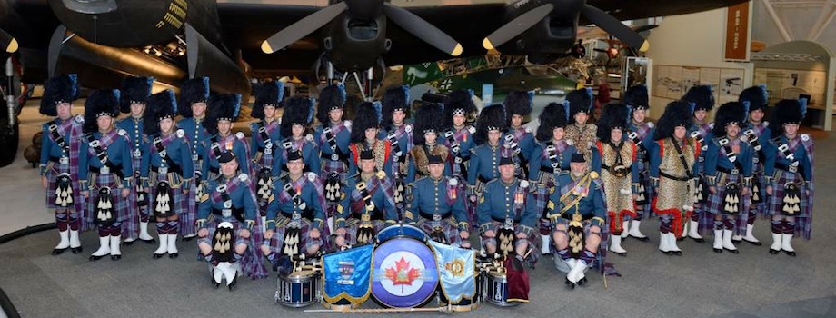The Royal Canadian Air Force Pipes and Drums in full regalia including the Royal Canadian Air Force tartan gather in front of a Lancaster bomber on the display floor of the Canada Aviation and Space Museum in Ottawa, Ontario, in 2014. PHOTO: DND