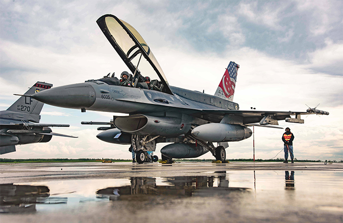 slide - A fighter jet rests on the tarmac