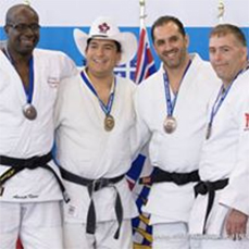From left, Amath Kane (Québec), Master Corporal Thompson's final opponent at the Nationals; Master Corporal Brent Thompson (Manitoba); Renato Cesar Donini (Québec); and Troy Alexander (New Brunswick) celebrate their medals after the 2017 Canadian National Open Judo Championships, held May 25–28, 2017, at the Olympic Oval in Calgary, Alberta. PHOTO: Rafal Burza/Judo Canada