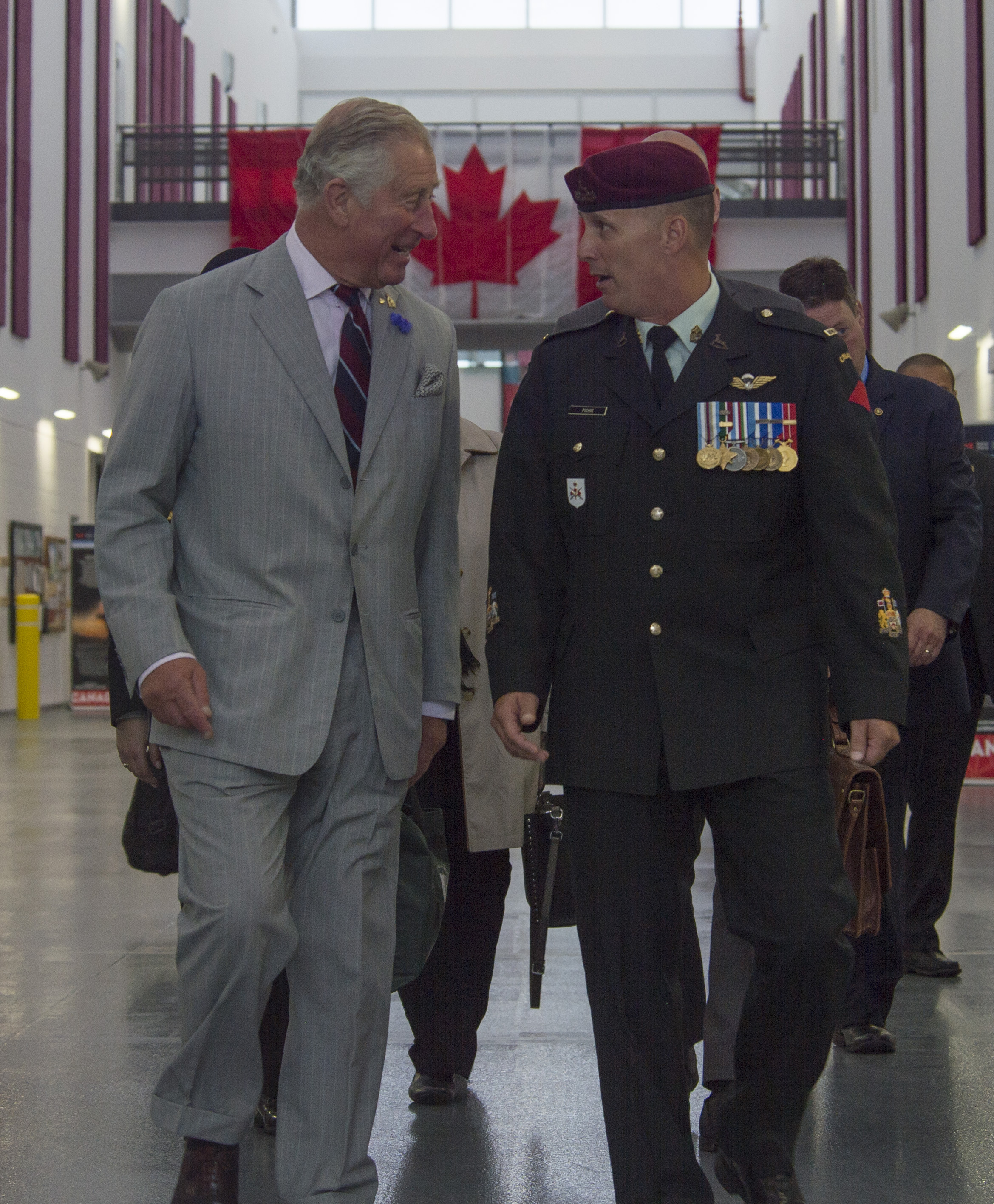 Accompanied by Chief Warrant Officer Kenneth Pichie, the Canadian Army Advanced Warfare Centre regimental sergeant-major, Prince Charles arrives at the Canadian Army Advanced Warfare Centre to see search and rescue, and paratrooper demonstrations at 8 Wing Trenton, Ontario, on June 30, 2017. PHOTO: Corporal Ryan Moulton, TN11-2017-0398-004