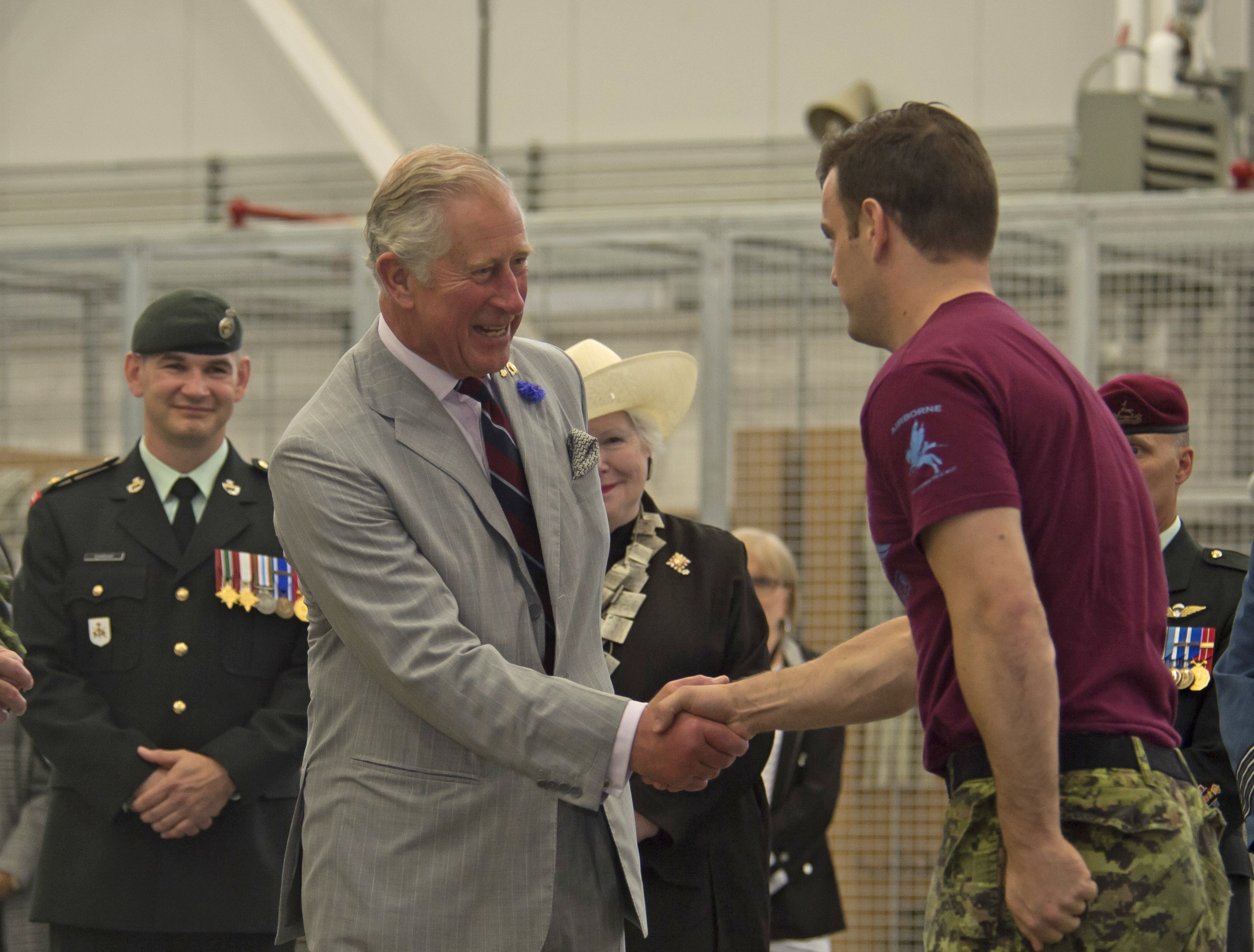Prince Charles shakes hands with Corporal Marc Dumaine, a parachute systems packer at the Canadian Army Advanced Warfare Centre in Trenton, Ontario, on June 30, 2017. PHOTO: Corporal Ryan Moulton, TN11-2017-0398-018