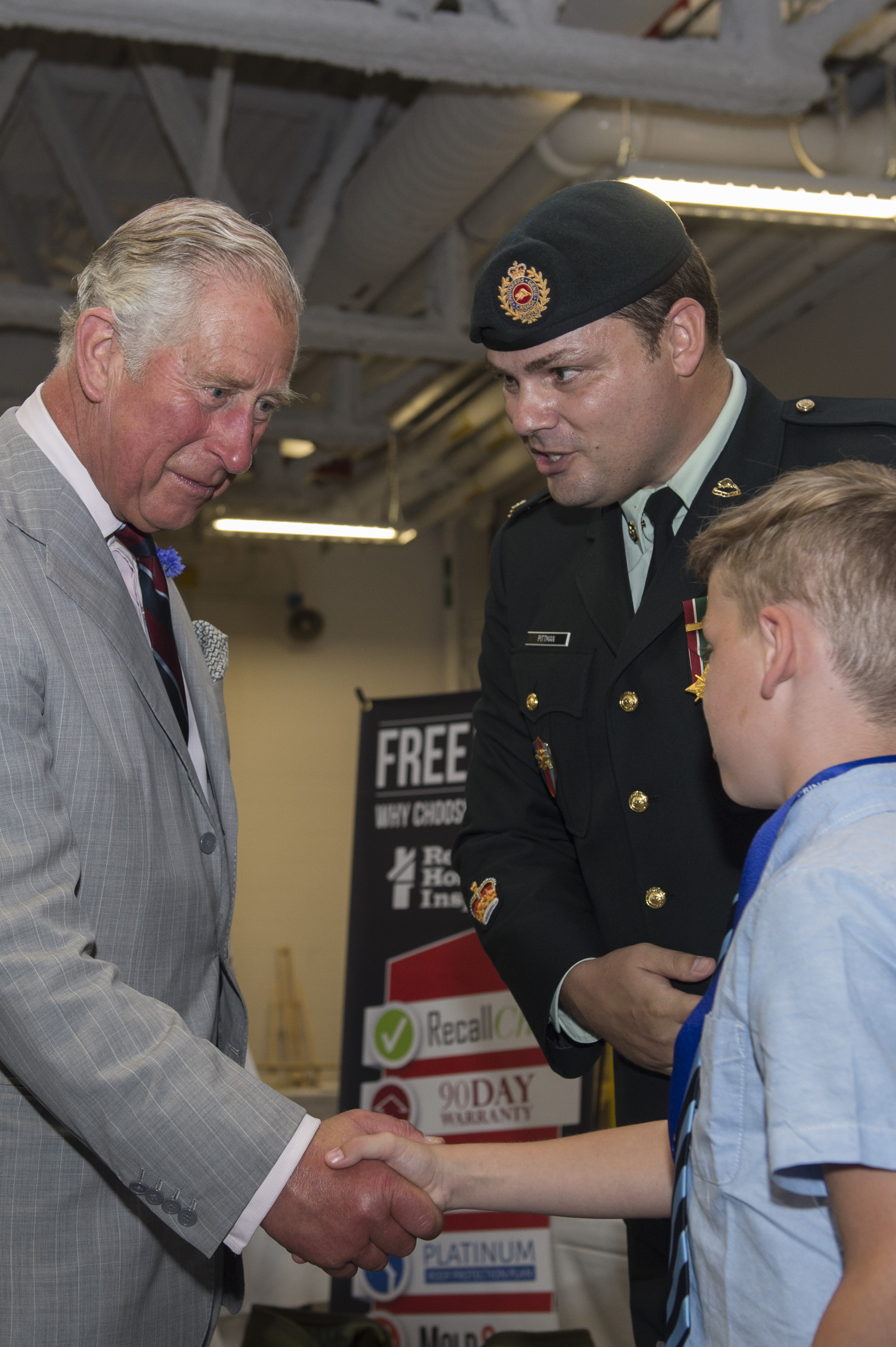 Prince Charles shakes hands with Cade Pittman, son of Warrant Officer Damien Pittman, during his visit to the Canadian Army Advanced Warfare Centre in Trenton, Ontario, on June 30, 2017. PHOTO: Ryan Moulton, TN11-2017-0398-029