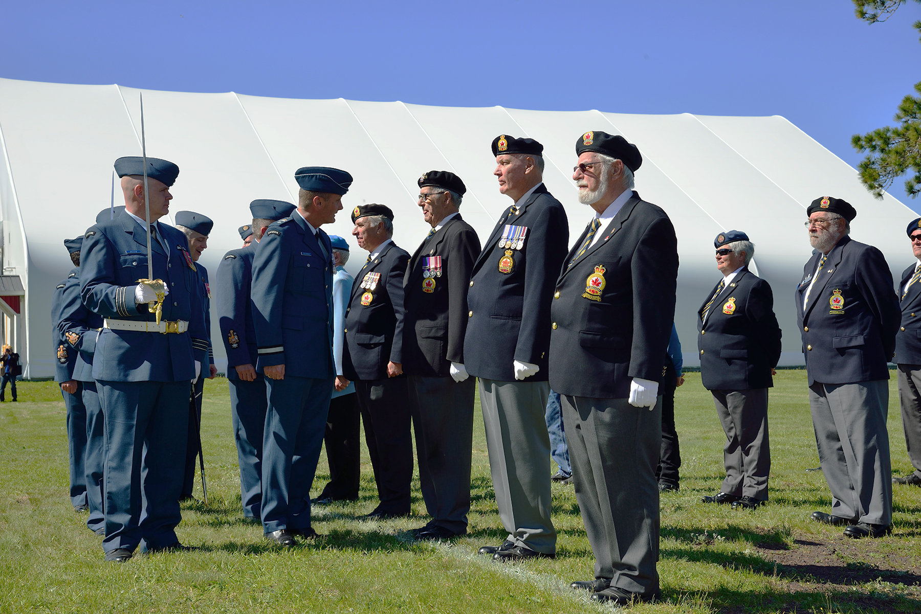 On the occasion of the June 3, 2017, rededication of the newly rebuilt Royal Canadian Air Force Memorial at 16 Wing/Canadian Forces Base Borden, Ontario, reviewing officer Brigadier-General David Cochrane, 2 Canadian Air Division Commander, inspects the veterans flights with Lieutenant-Colonel Russell Defer, parade commander. PHOTO: Sergeant Christopher Bentley, BM01-2017-0174-28
