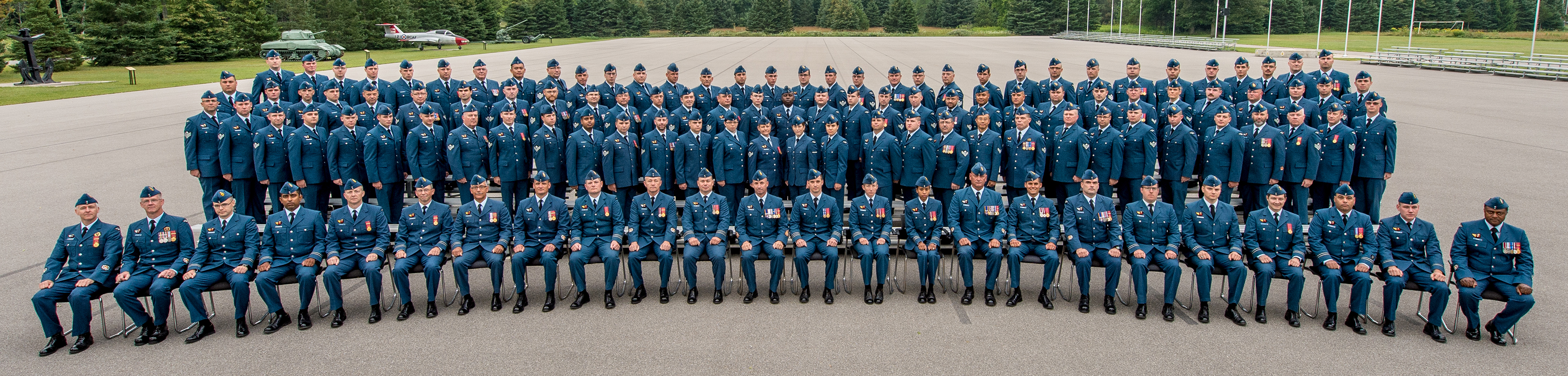 "The ""Consecration Team"" – the more than 100 airmen and airwomen who will participate in the RCAF Colours presentation ceremony and parade that will be held at Nathan Phillips Square in Toronto on September 1, 2017 – pause during rehearsals for a group photo. PHOTO: Ordinary Seaman Larissa Halldorson"