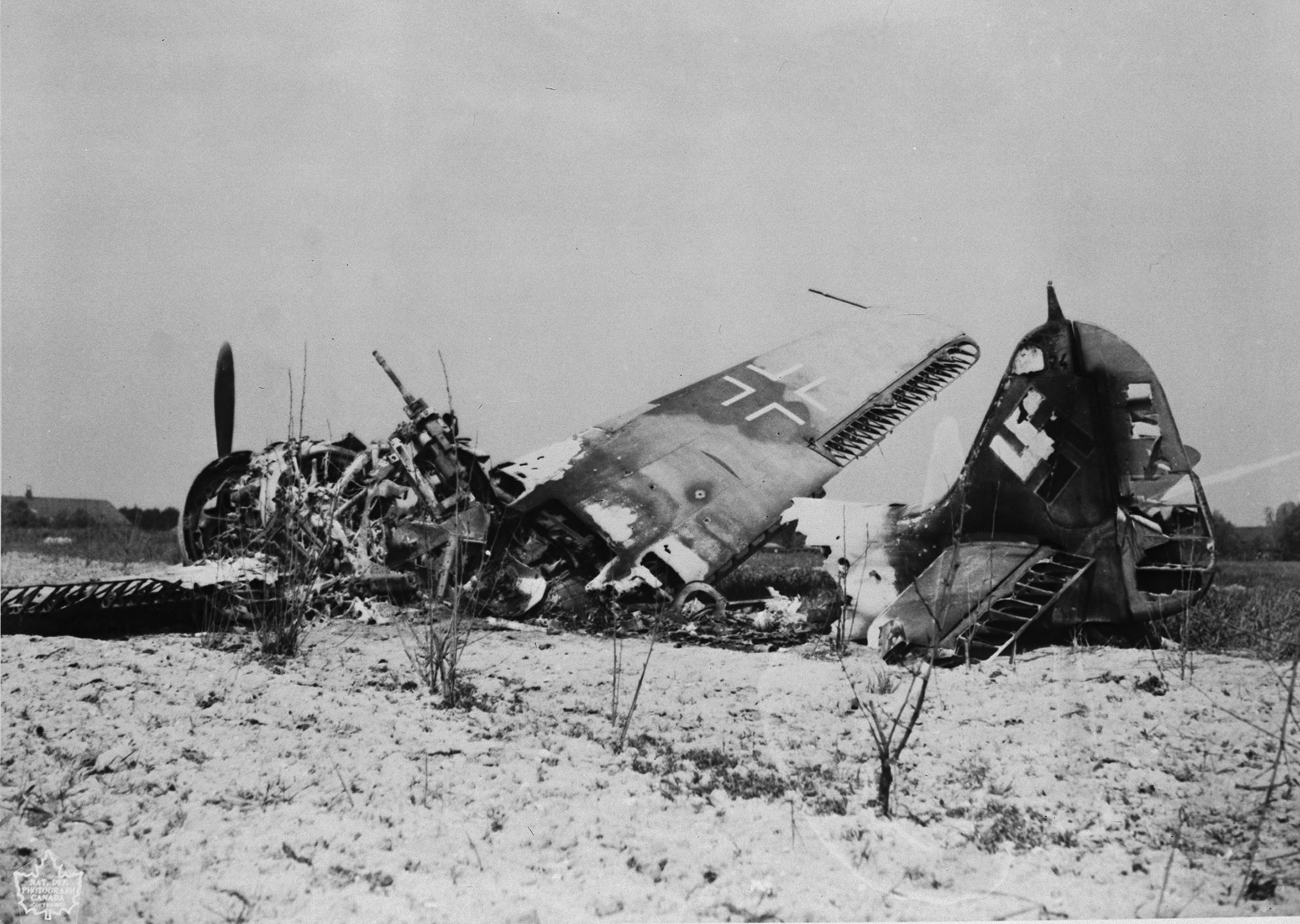 An undated photograph of the goal of every Allied airman flying during the Battle of Britain: a downed enemy aircraft in rough land in southern England. PHOTO: DND Archives, PL-129315