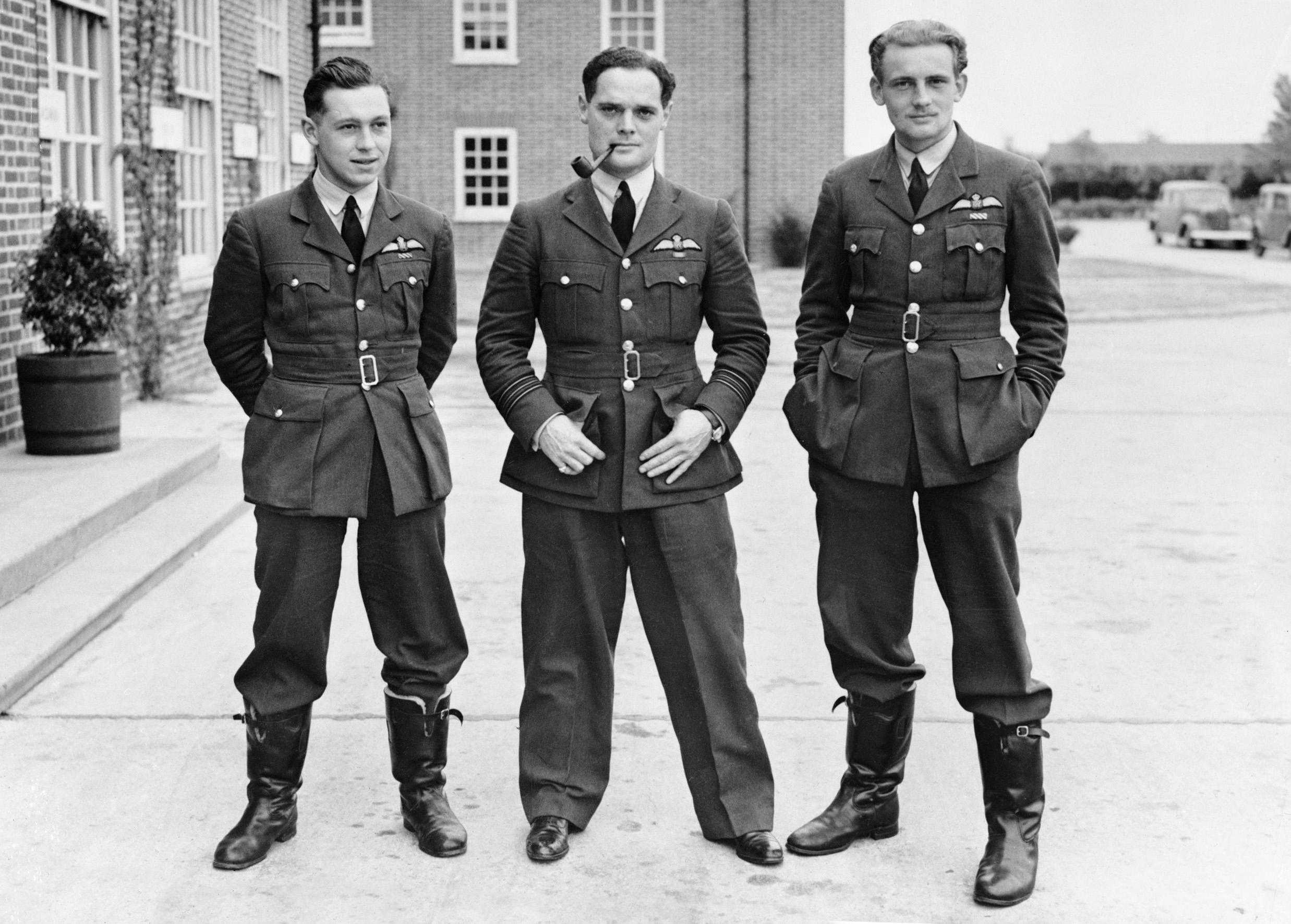 A black and white photo of three men in military uniforms.