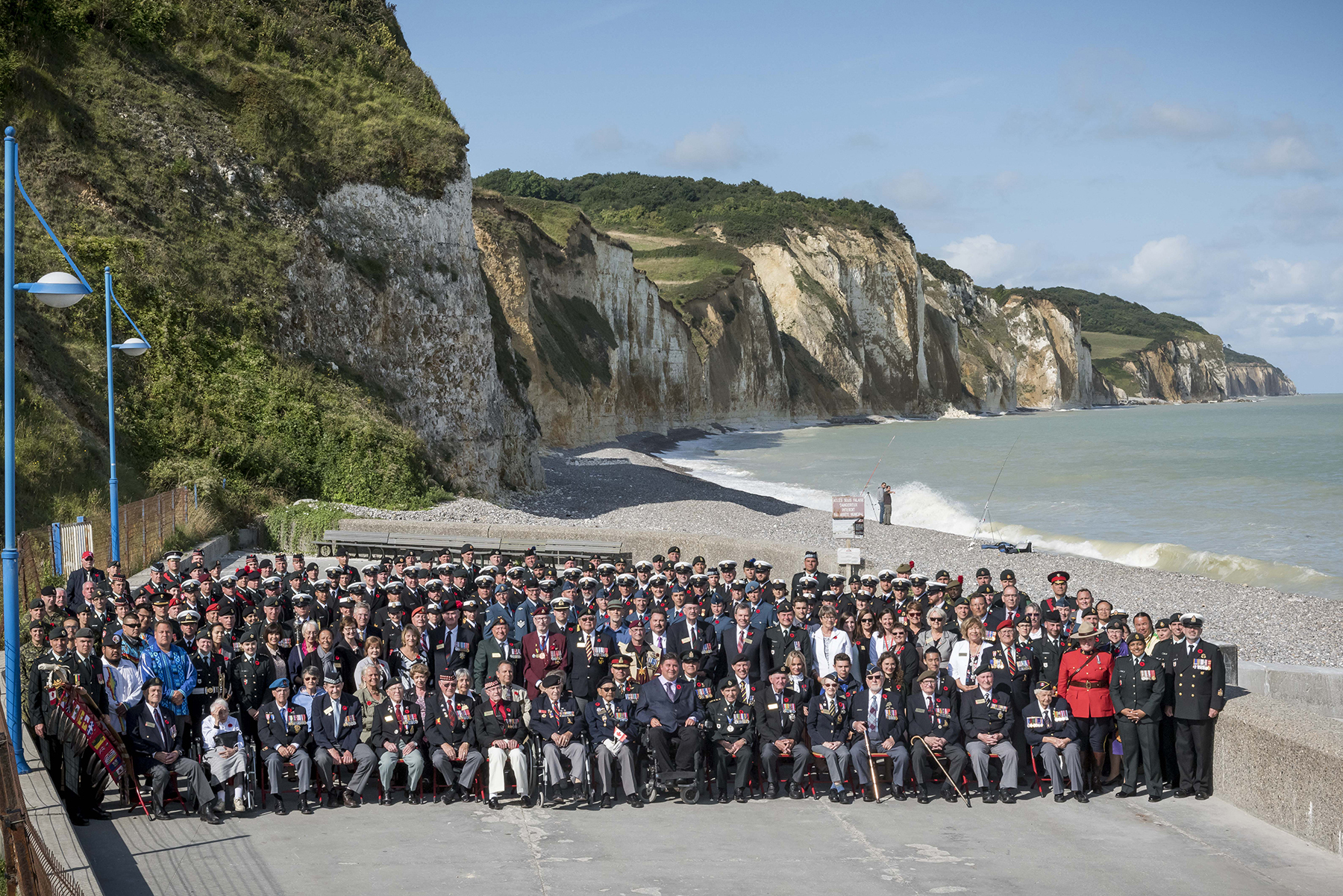 Members of the Canadian Contingent, comprising 120 Canadian Armed Forces personnel, and veterans, family members and friends, gather on a beach at Dieppe, France, during an August 11 to 21, 2017, visit marking the 75th anniversary of the Dieppe Raid during the Second World War. PHOTO: Corporal Andrew Wesley