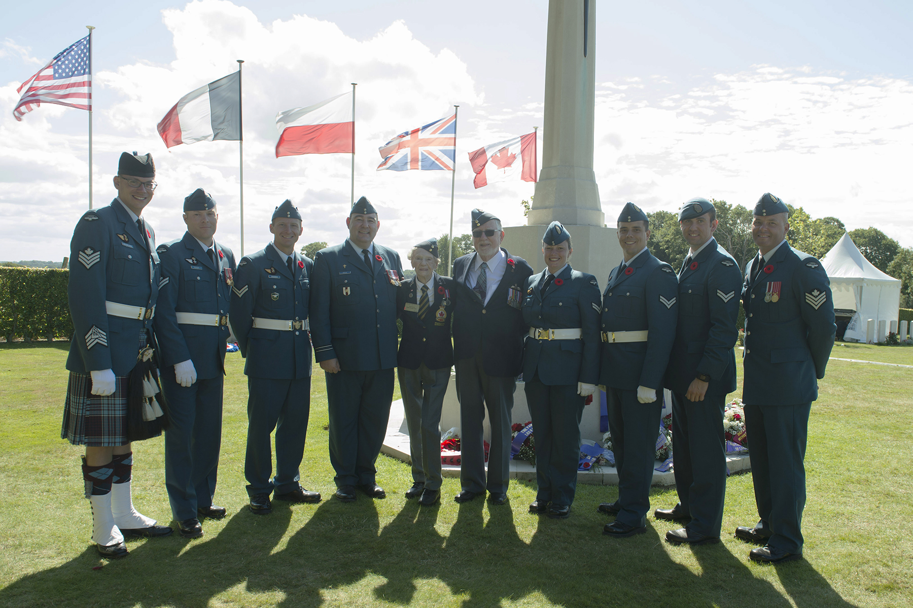 From left, Sergeant Joshua McFarlane, Master Corporal Hugo Belisles, Corporal Alexandre Dingman, nursing officer Captain Cory Fryia, veteran Leading Airwoman Ruth Kells (served 1943-1946), veteran Flight Lieutenant George Brewster (served 1942-1967), Corporal Crystal Roche, Corporal Maxime Caron, Corporal Andrew Kelly, and Sergeant Jeffery Ryan, gather for a photograph at the Canadian War Cemetery during the Canadian Armed Forces' visit to France from August 11 to 21, 2017, to mark 75th anniversary of the Dieppe Raid during the Second World War. PHOTO: Submitted