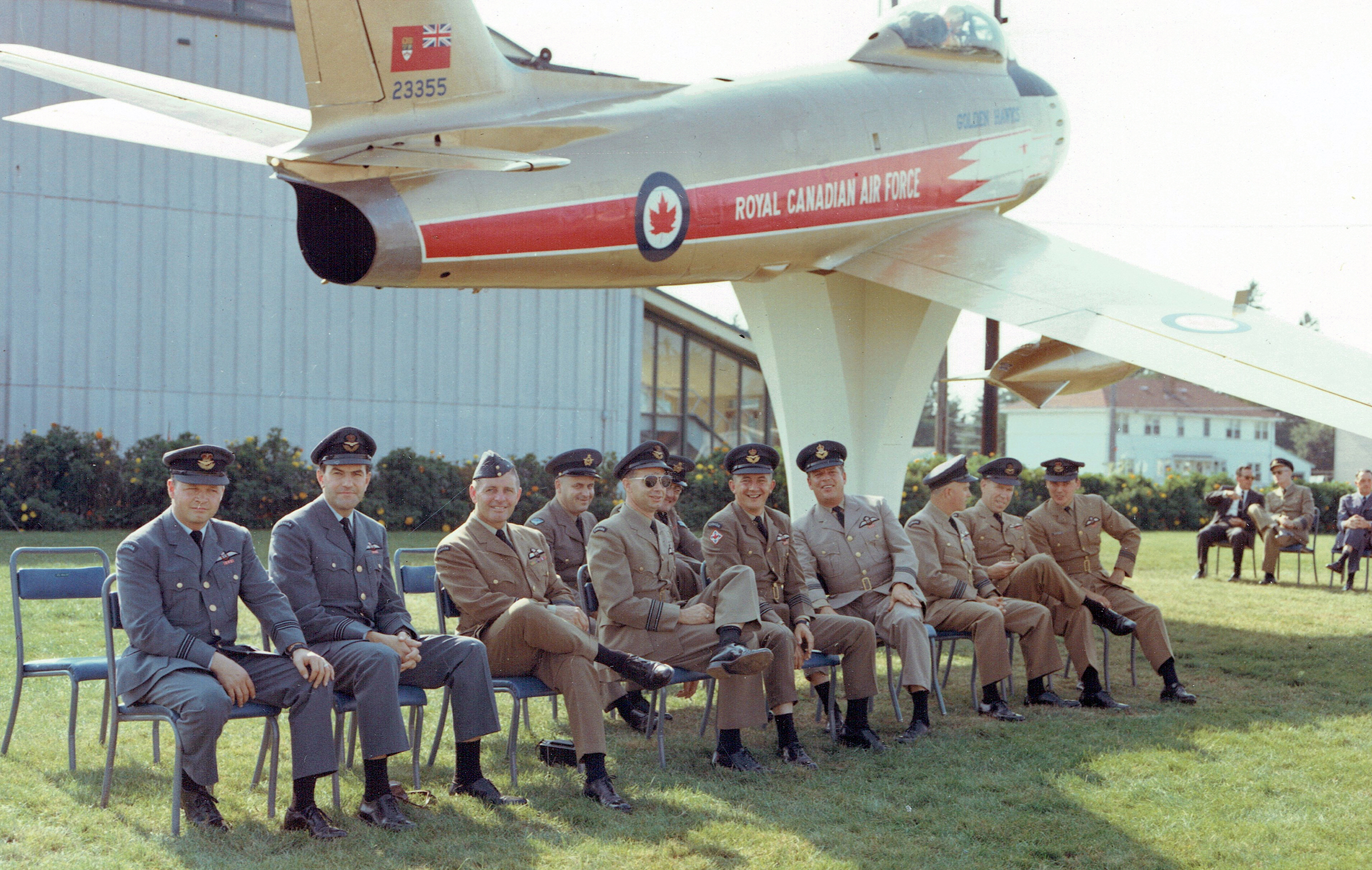 The first Golden Hawks Appreciation Day was held September 16, 1967, at RCAF Station Chatham, New Brunswick. Seated, left to right, are Bill Stewart, Ed Rozdeba, Lloyd Hubbard, Bob Dobson, Jim McCombe, JT Price, Ray Archer, Alf McDonald and Ed McKeogh (the only person from this photo to attend the 2017 reunion). In the back row are Grant McEathron (left) and Norm Gray. The Sabre was unveiled that same day. After the Chatham base closed in 1996, the aircraft was transferred to the Atlantic Canada Aviation Museum, near the Stanfield International Airport in Halifax, Nova Scotia, where it still bears the Golden Hawks livery, although this particular aircraft did not actually fly with the team. PHOTO: Corporal R. Johnson