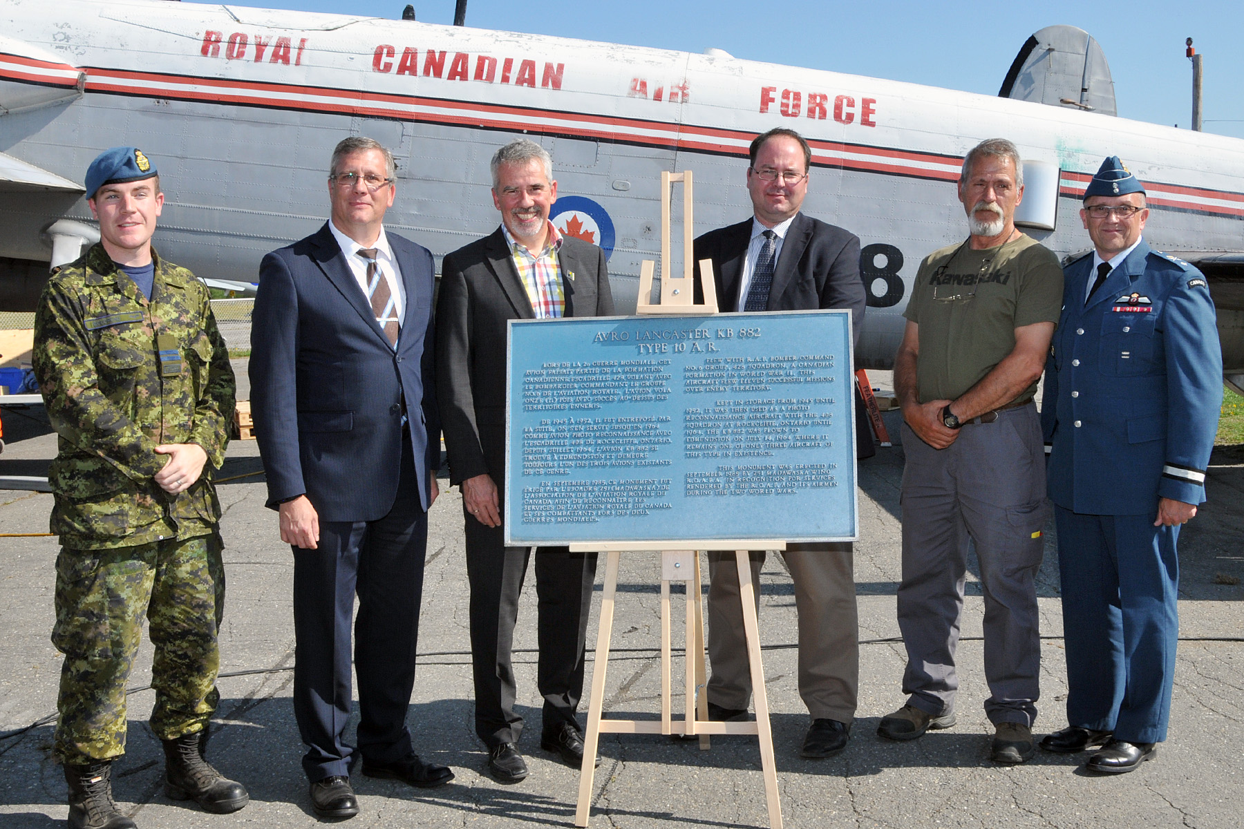 Gathered around the plaque presented by the Edmundston mayor to the National Air Force Museum are (from left) Captain Jamie Boudreau of ATESS, heading the team dismantling KB882; Kevin Windsor, museum curator; Mayor Cyrille Simard; Dr. Richard Mayne, the RCAF's chief historian; Mike Joly, head of the restoration shop at the museum; and Brigadier-General Scott Howden of the RCAF. PHOTO: Warrant Officer Fran Gaudet