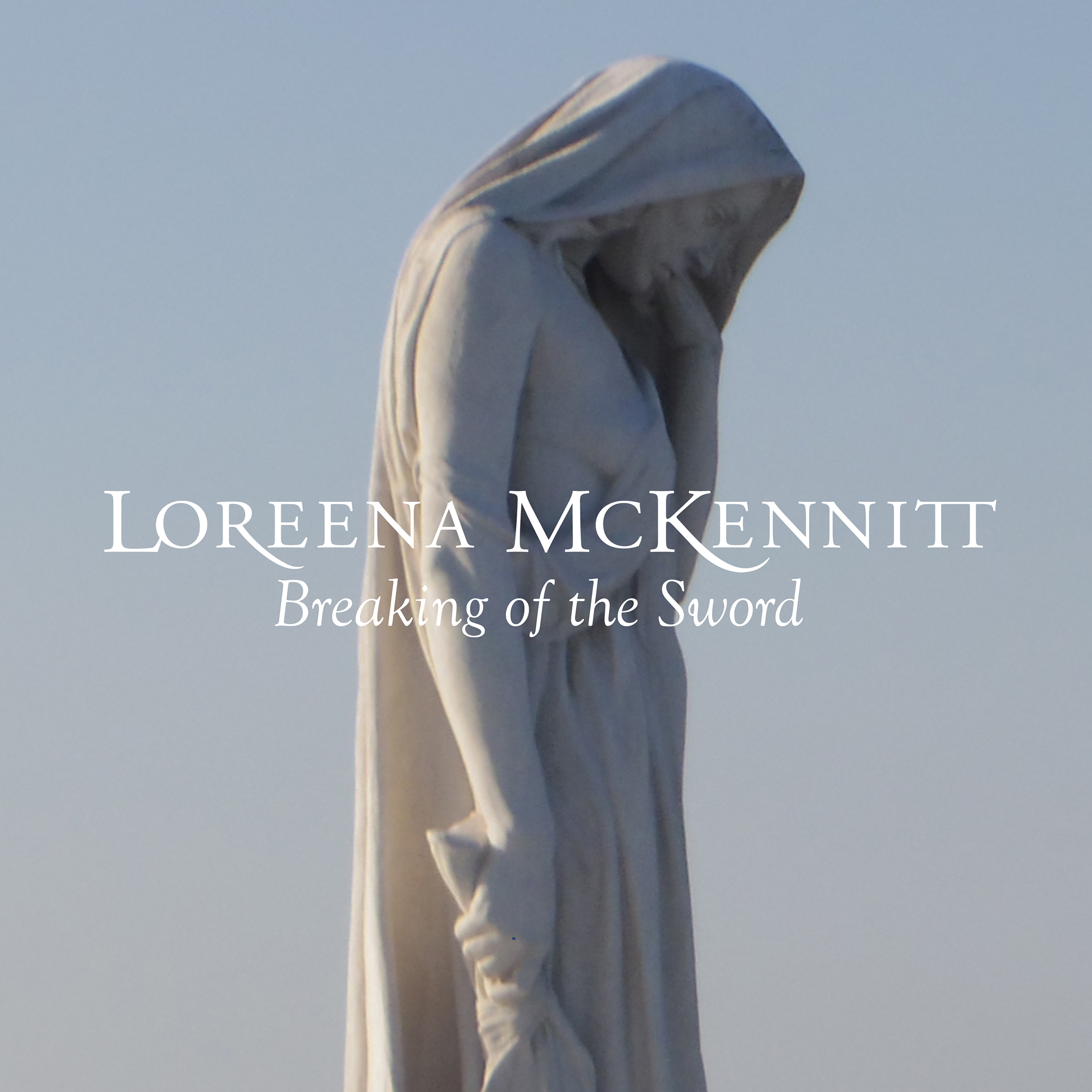 "An image of a marble statue of a woman, looking down, wearing a draped garment that also covers her hair. Written across the image are the words ""LOREENA MCKENNITT Breaking of the Sword"""