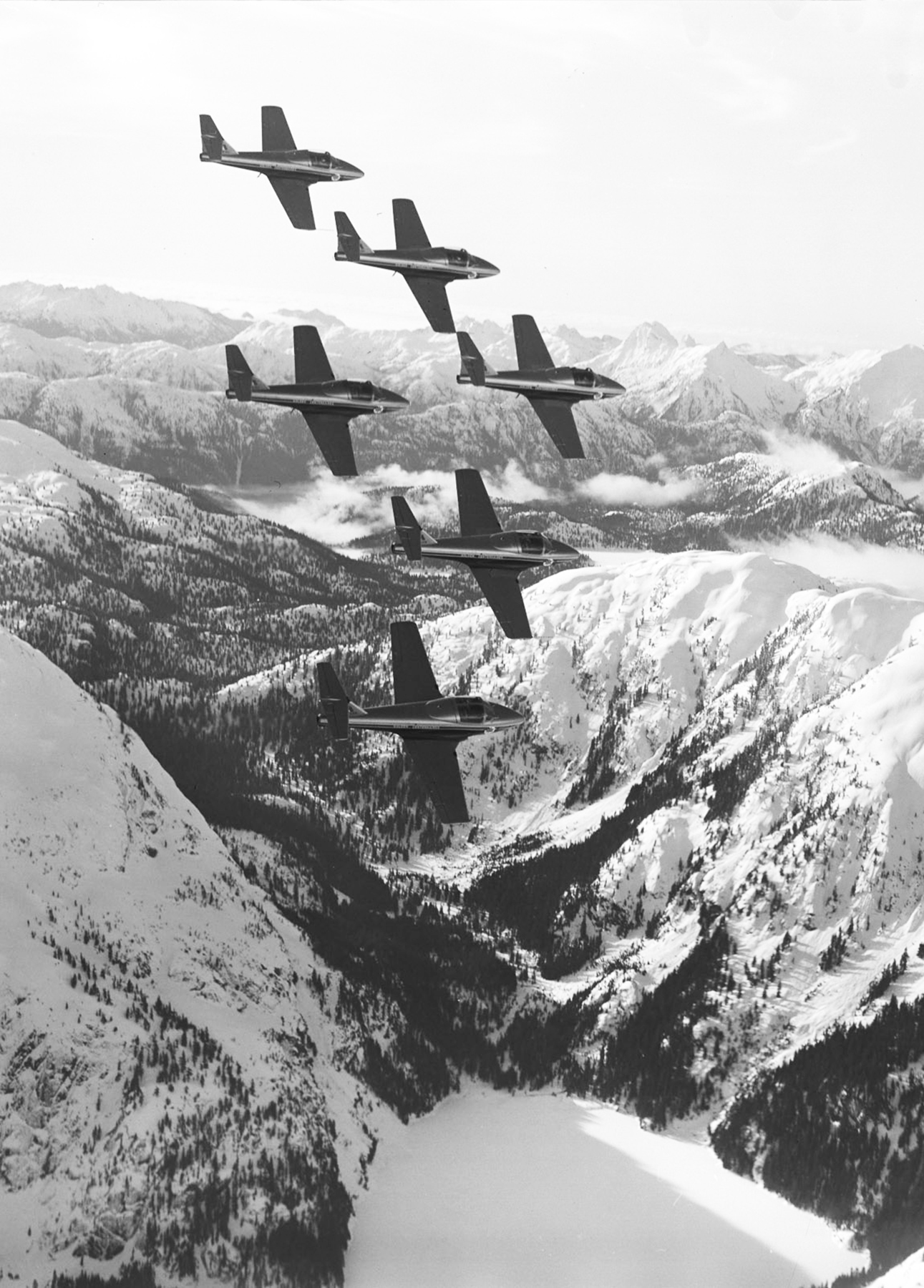 On February 4, 1967, the Canadian Armed Forces Golden Centennaires execute a tight formation of six over the Rocky Mountains near Comox, British Columbia. PHOTO: DND Archives, WG67-13-4