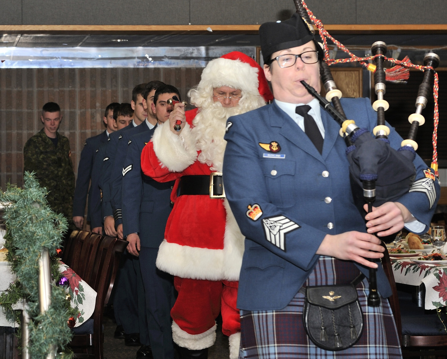 Santa Claus is piped into the 12 Wing Shearwater, Nova Scotia, Junior Ranks Christmas Dinner on December 16, 2016. PHOTO: Corporal Jennifer Robinson-McGuire, SW08-2016-0361-008