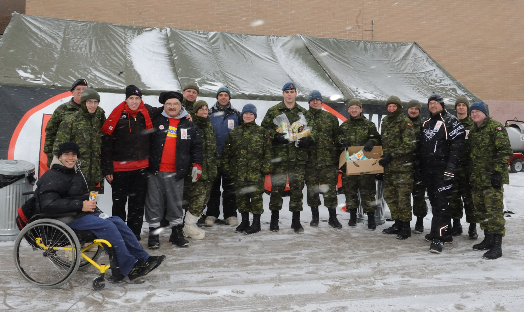 On December 5, 2008, members of 17 Wing Winnipeg Logistics and Engineers helped out with One Big Day for Christmas food collections in collaboration with Hot 103 and QX104.1. PHOTO: Corporal Colin Aitken, WG2008-0470-06