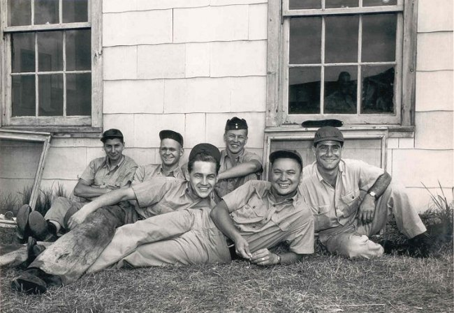 "Members of 430 Squadron at Bagotville, Quebec, on Operation Signpost, in 1952. They are wearing red caps donated by Carling Brewery to all members of the squadron. ""The commanding officer wasn't too pleased"", according to the original caption of the photo. PHOTO: Courtesy of Don Hines via www.c-and-e-museum.org"