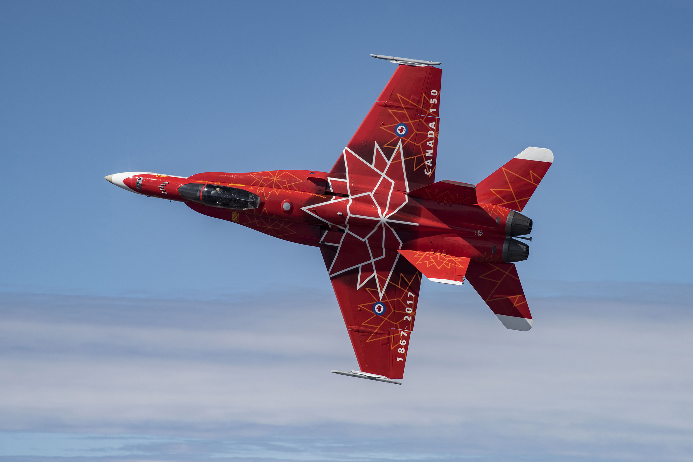 The design of the Royal Canadian Air Force's 2017 CF-18 Demonstration Hornet, commemorating the 150th anniversary of Canadian Confederation, inspired the design of Canada's 2018 Olympic bobsleigh and skeleton sleds. PHOTO: Corporal Manuela Berger, CK01-2017-0278-009