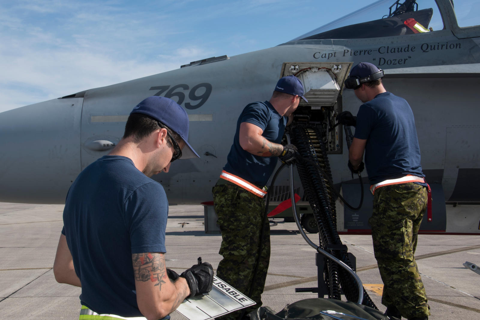 "Weapons technicians unload ammunition from a CF-188 Hornet after a training mission during CHUMEX at the Homestead Air Reserve Base in Florida on February 2, 2017. The new ""MNET"" online ""job translation"" tool is aimed at helping serving and former members of the Canadian Armed Forces transition to civilian life. PHOTO: Corporal Jean-Roch Chabot, BN02-2017-0036-113"