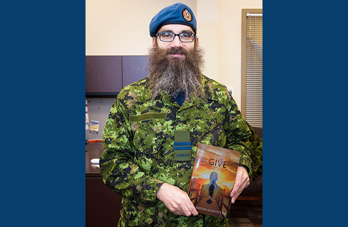slide - A bearded man wearing a military uniform holds a book.