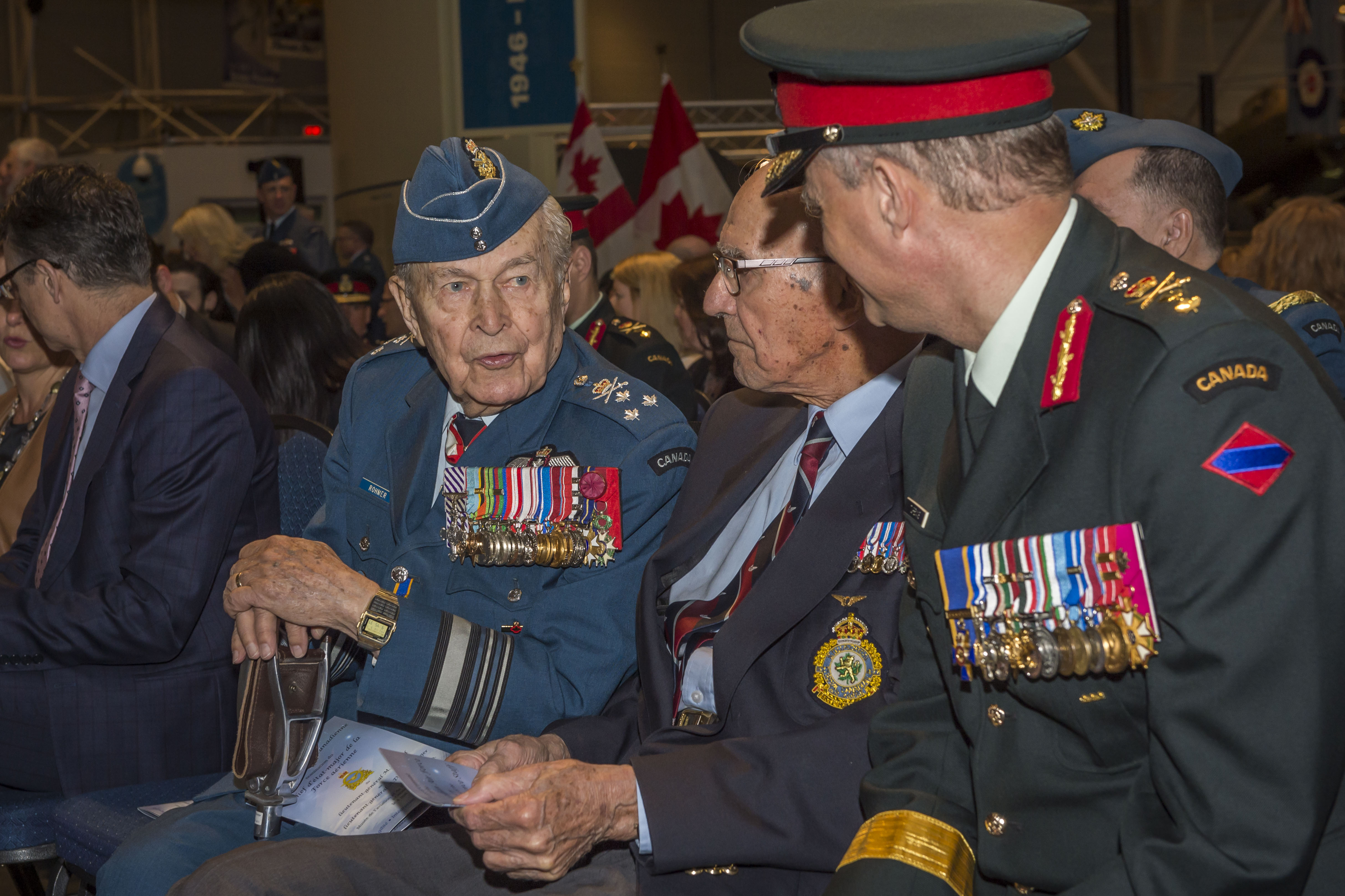 From left, Honorary Lieutenant-General Richard Rohmer, honorary advisor to the chief of the defence staff and a Second World War veteran; Mr. Stuart Vallières, a Second World War veteran of Bomber Command and special guest of Lieutenant-General Meinzinger, and Major-General Carl Turenne, deputy commander of the Canadian Army, chat before the Change of Command ceremony. PHOTO: Corporal Alana Morin, FA03-2018-0040-014