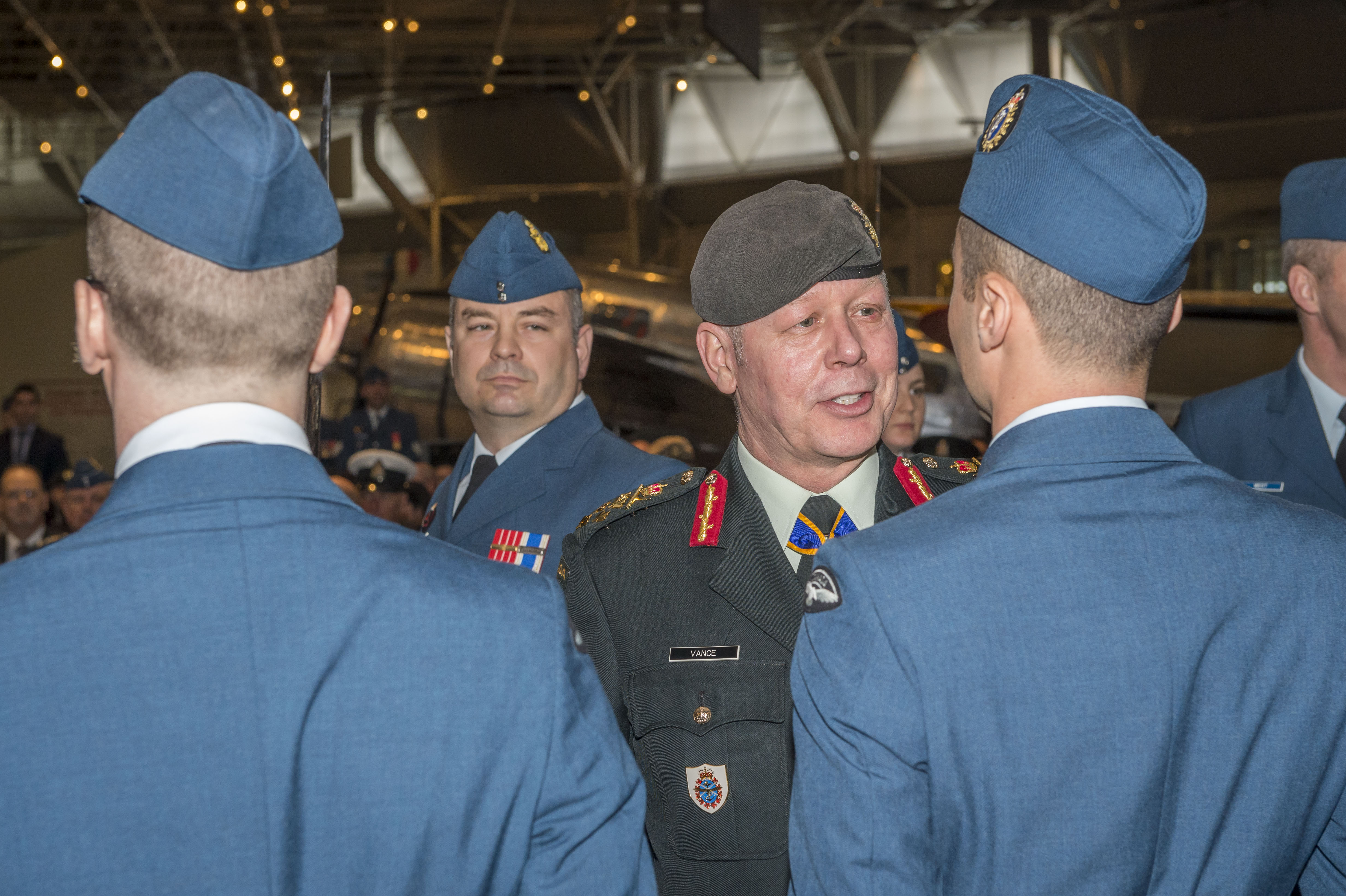 General Jonathan Vance, chief of the defence staff, chats with a member of the Royal Canadian Air Force during the inspection of the Guard of Honour as part of the Change of Command ceremony. PHOTO: Corporal Alana Morin, FA03-2018-0040-029