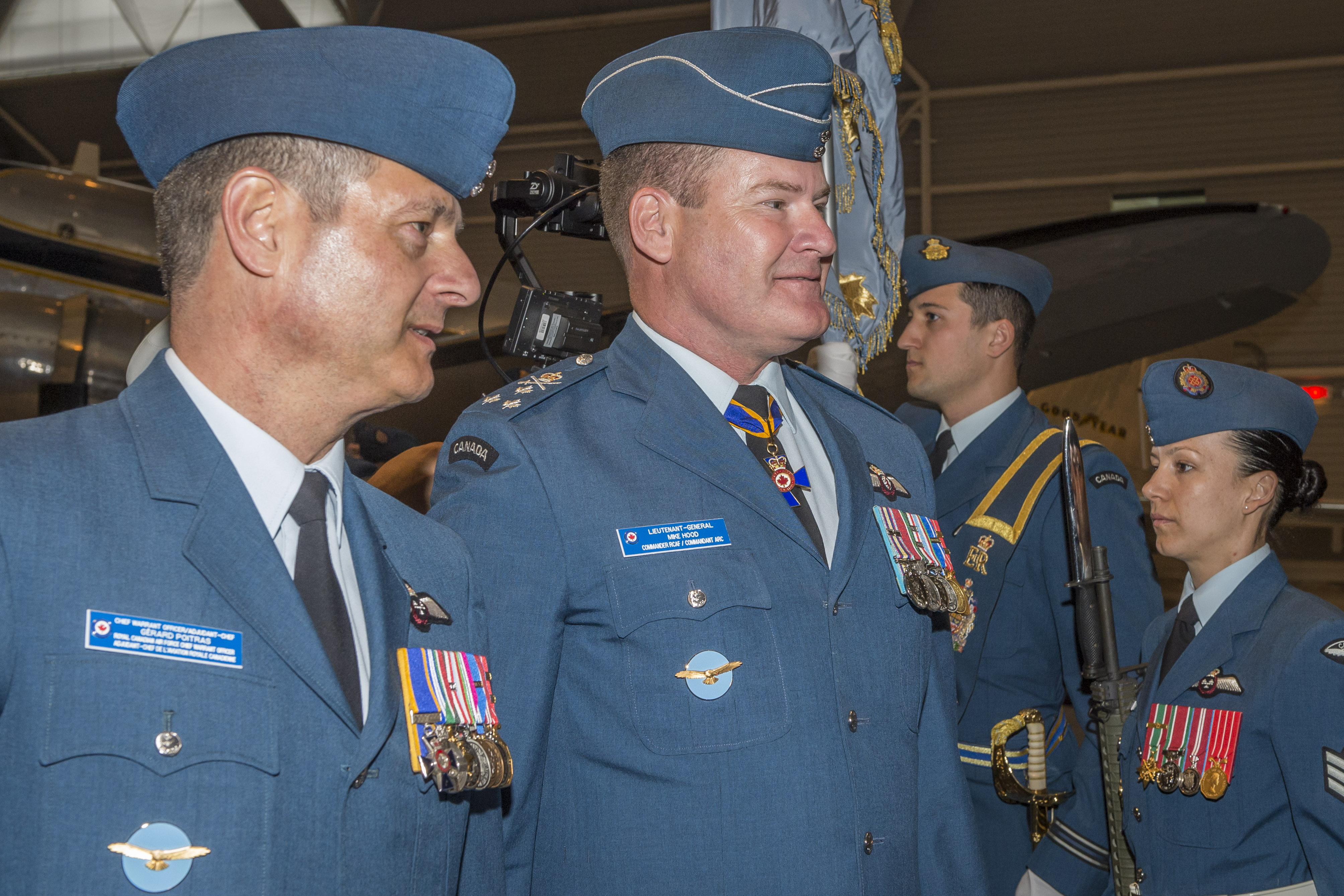 Chief Warrant Officer Gérard Poitras (left), RCAF command chief warrant officer, and Lieutenant-General Mike Hood, outgoing commander of the RCAF, inspect the Guard of Honour – their final task together as members of the RCAF Command Team – during the Change of Command ceremony. PHOTO: Corporal Alana Morin, FA03-2018-0040-030