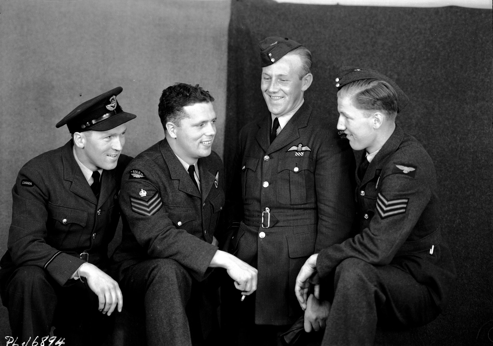 "A group of RCAF personnel who took part in the Dambusters raid was photographed while on leave in London, England, shortly after the operation. From left to right:  Flight Lieutenant David Rodger, Flight Sergeant Donald A. MacLean, Flight Lieutenant Joseph Charles ""Joe"" McCarthy and Sergeant William Radcliffe.  PHOTO: DND Archives, PL-16894"