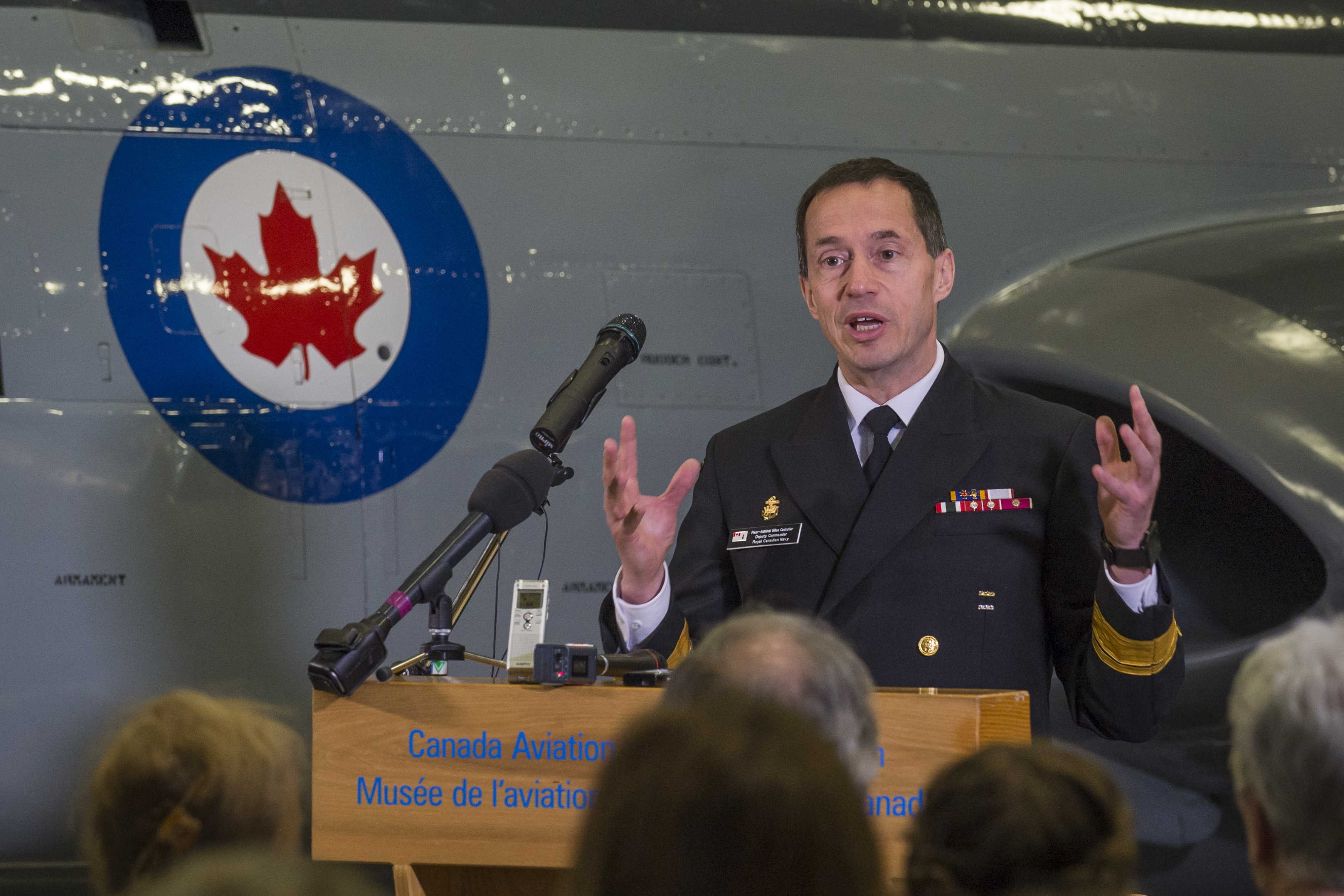 Rear Admiral Gilles Couturier speaks to the Troy family and members of the RCN and RCAF about being part of a family. PHOTO: Corporal Alana Morin, FA03-2018-0038-047
