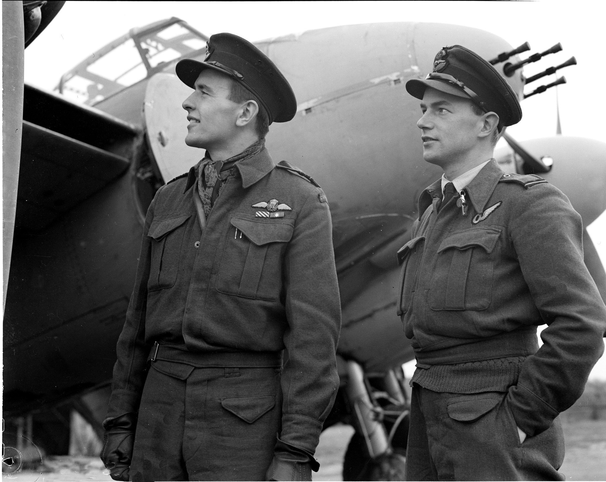 On August 29, 1944, Squadron Leader Russ Bannock (left), DFC, and his navigator, Flying Officer Robert Bruce look at the starboard engine of their Mosquito aircraft that brought them back to their station after their port engine was knocked out by flak. They destroyed two enemy aircraft in the air before they were forced to limp home on the one engine. In October 1944, Wing Commander Bannock took command of 418 Squadron; he was inducted into Canada's Aviation Hall of Fame in 1983. PHOTO: DND Archives, PL-33041