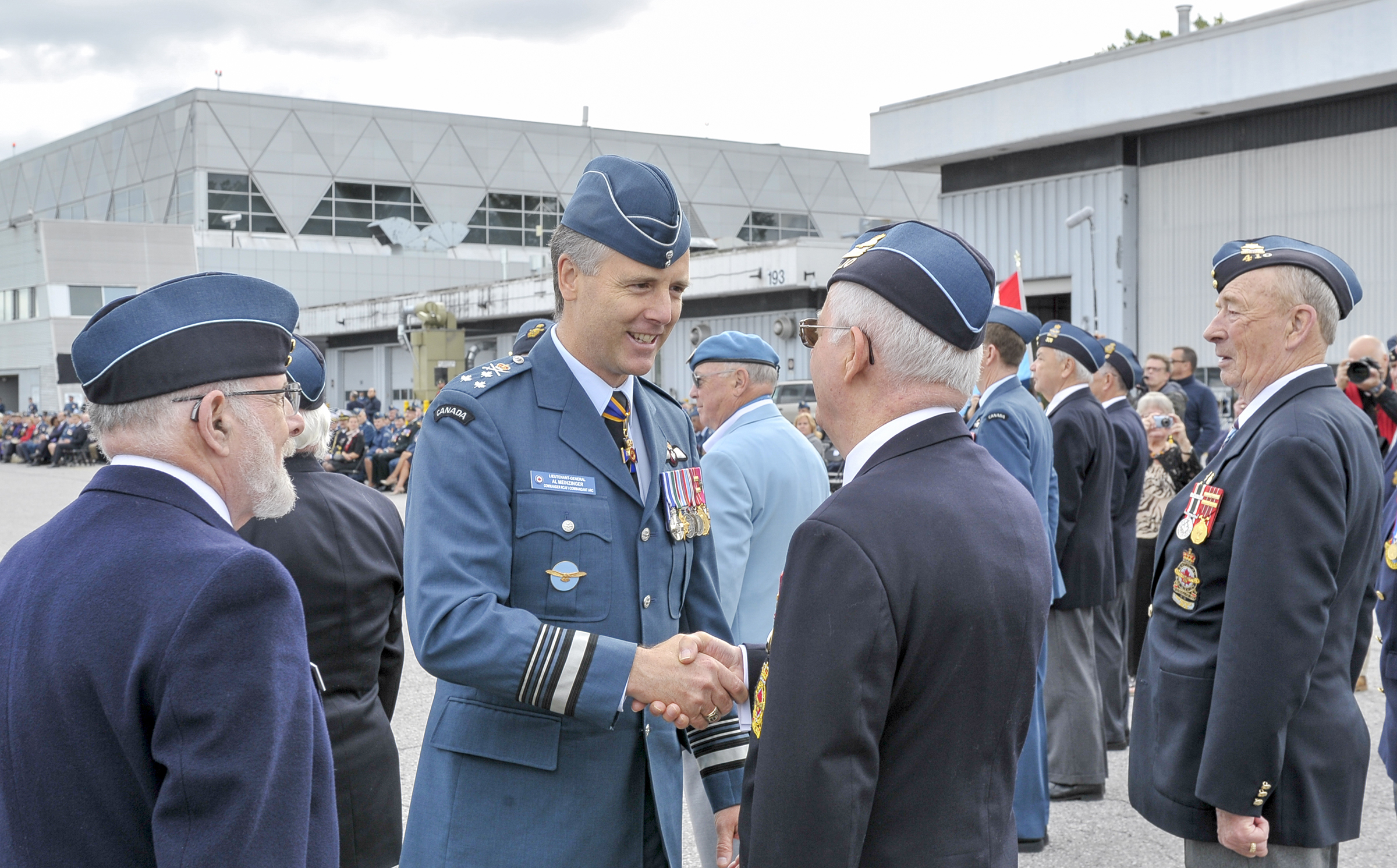 Lieutenant-General Al Meinzinger, commander of the RCAF, shakes hands with a veteran during the inspection of the parade during the national Battle of Britain parade held September 15, 2019, at the Canada Aviation and Space Museum in Ottawa, Ontario. PHOTO: Aviator Jacob Hanlon, FA01-2019-0008-003-cropped