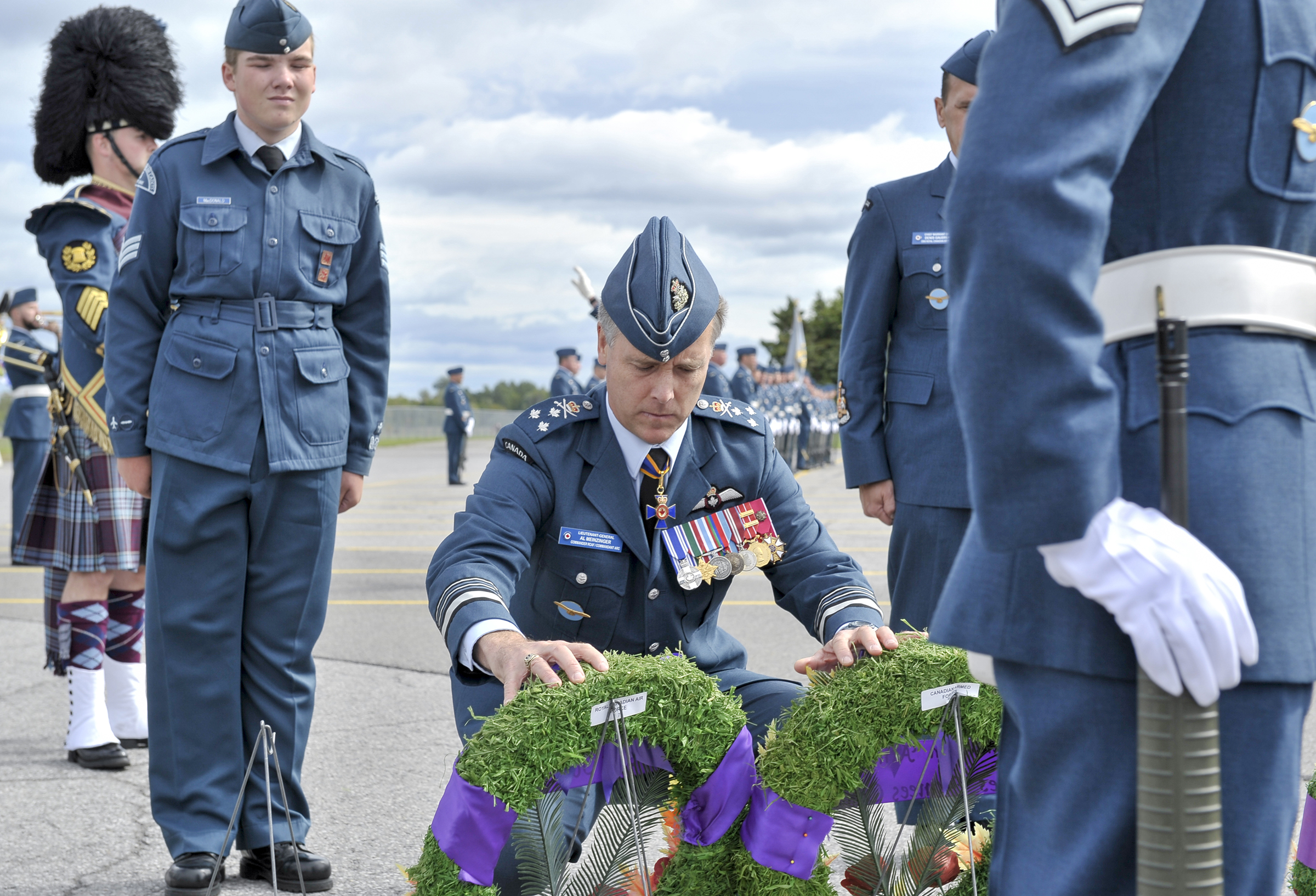 Lieutenant-General Al Meinzinger, commander of the RCAF, accompanied by  Sergeant Alexander MacDonald, a member of 5 Cyclone Royal Canadian Air Cadet Squadron, lays wreaths during the national Battle of Britain parade held September 15, 2019, at the Canada Aviation and Space Museum in Ottawa, Ontario. PHOTO: Aviator Jacob Hanlon, FA01-2019-0008-007