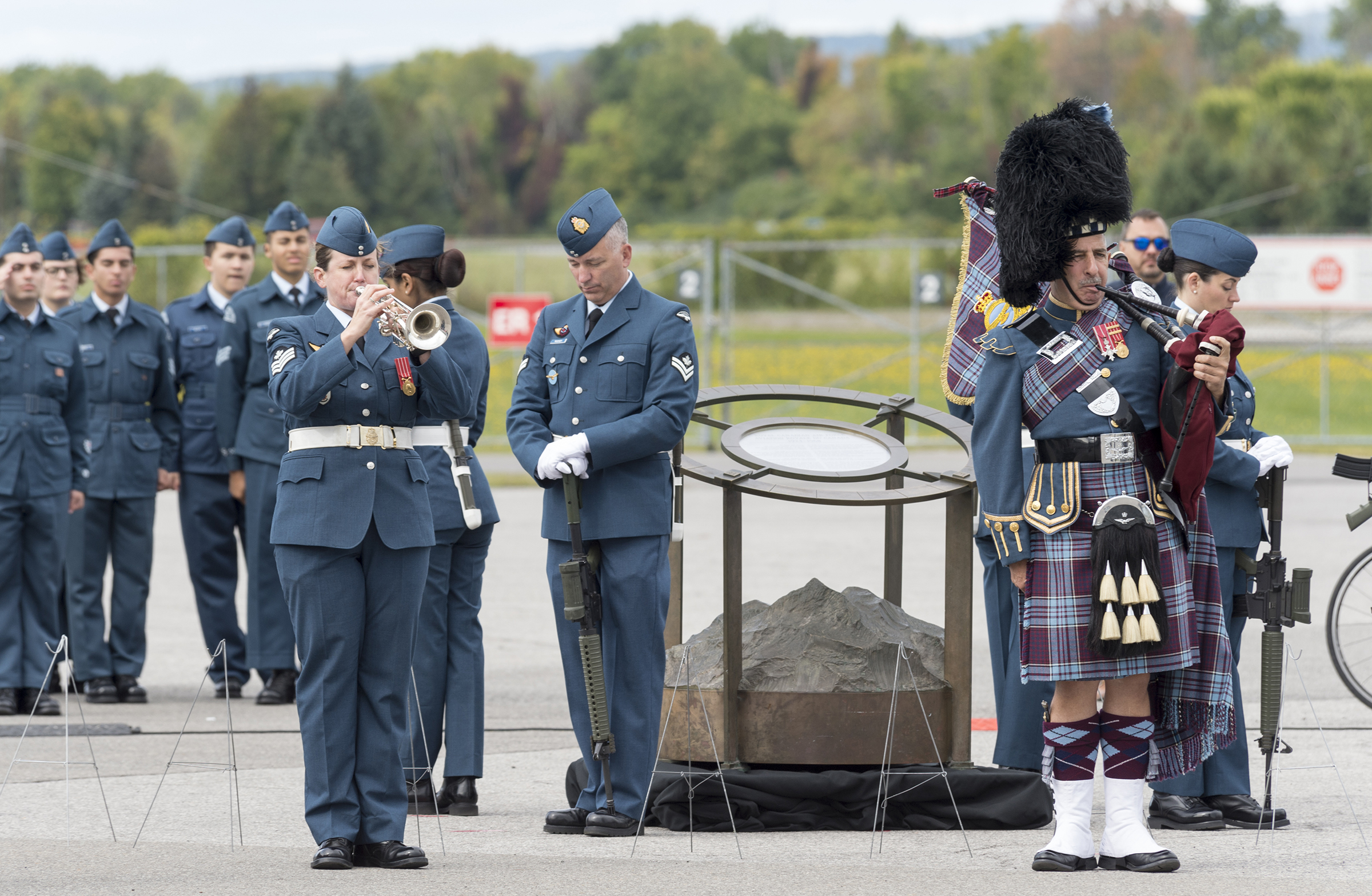 "The bugler plays ""The Rouse"" (Reveille) during the national Battle of Britain parade held September 15, 2019, at the Canada Aviation and Space Museum in Ottawa, Ontario. PHOTO: Aviator Jacob Hanlon, FA01-2019-0008-014"
