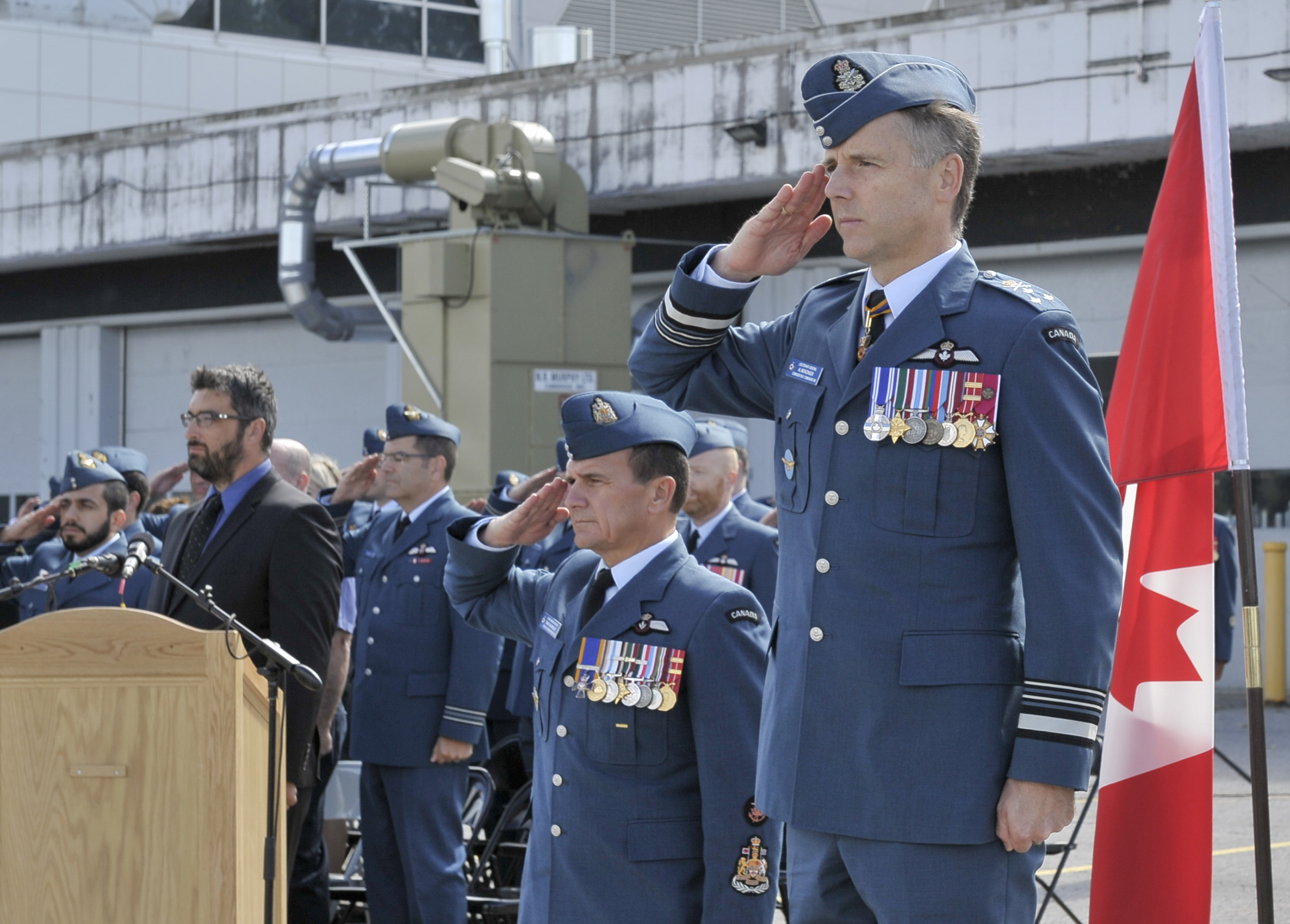 The commander of the RCAF, Lieutenant-General Al Meinzinger, and the command chief warrant officer of the RCAF, Chief Warrant Officer Denis Gaudreault, salute during the national Battle of Britain parade held September 15, 2019, at the Canada Aviation and Space Museum in Ottawa, Ontario. PHOTO: Aviator Jacob Hanlon, FA01-2019-0008-018