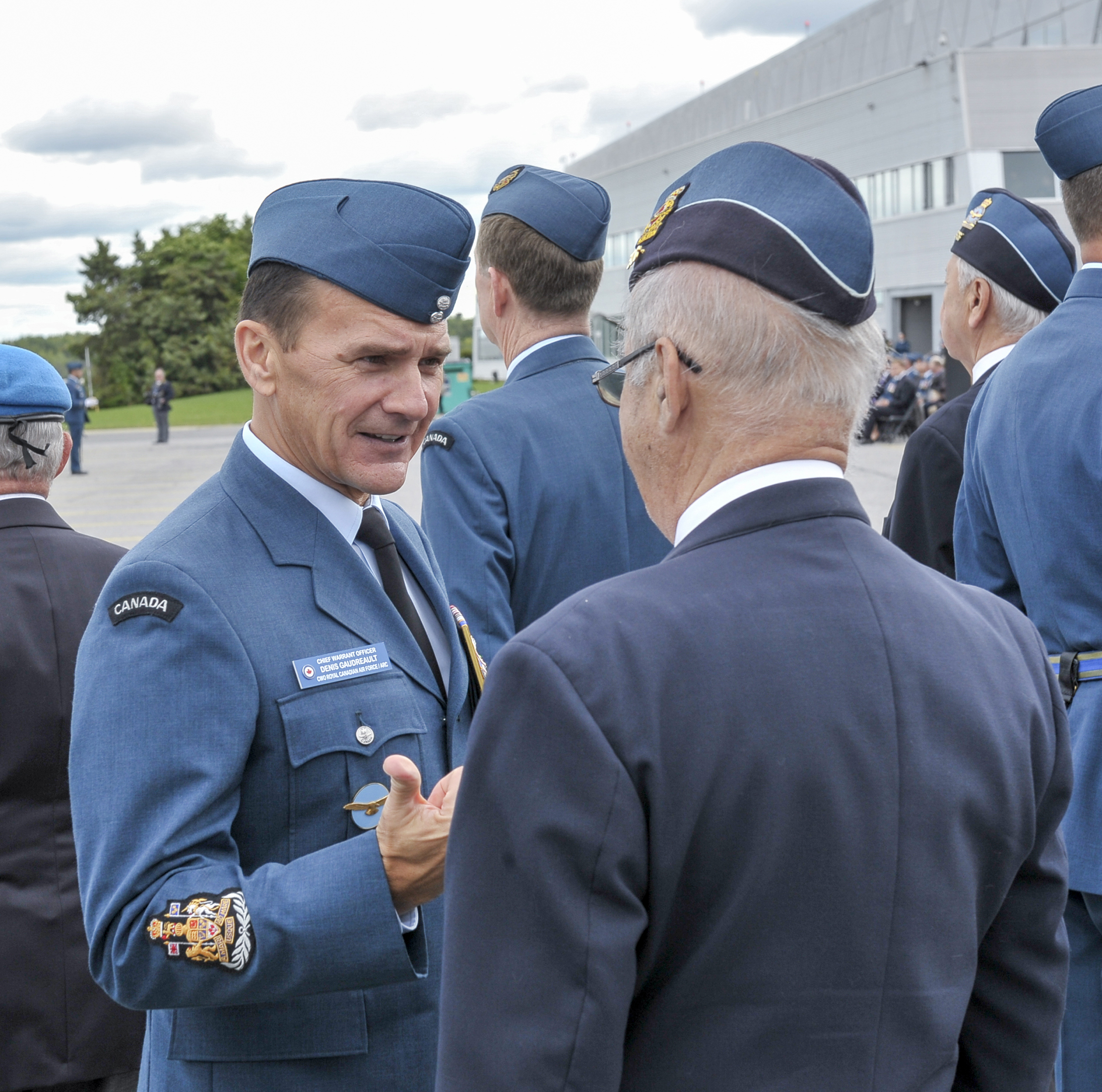 Chief Warrant Officer Denis Gaudreault, RCAF command chief warrant officer, pauses to speak with a veteran during the inspection of the parade during the national Battle of Britain parade held September 15, 2019, at the Canada Aviation and Space Museum in Ottawa, Ontario. PHOTO: Aviator Jacob Hanlon, FA01-2019-0008-021
