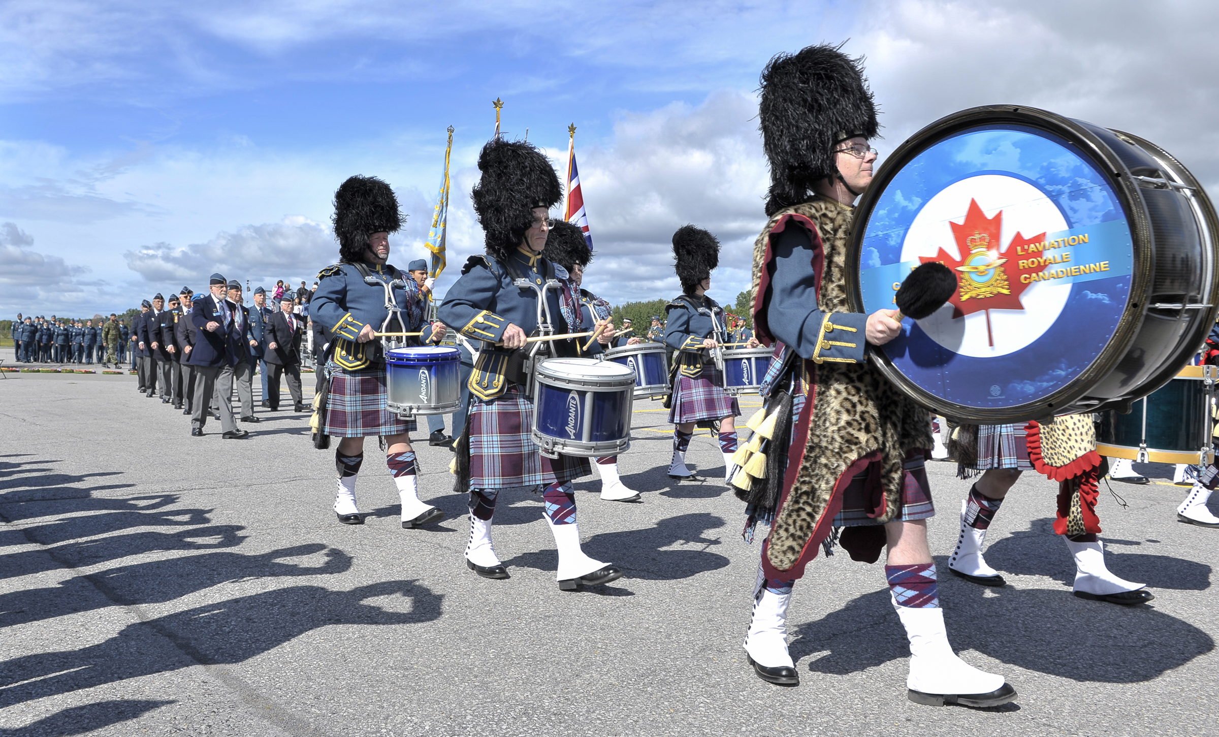 The Royal Canadian Air Force Pipes and Drums Band leads the veterans' contingent off the parade square during the national Battle of Britain parade held September 15, 2019, at the Canada Aviation and Space Museum in Ottawa, Ontario. PHOTO: Aviator Jacob Hanlon, FA01-2019-0008-024