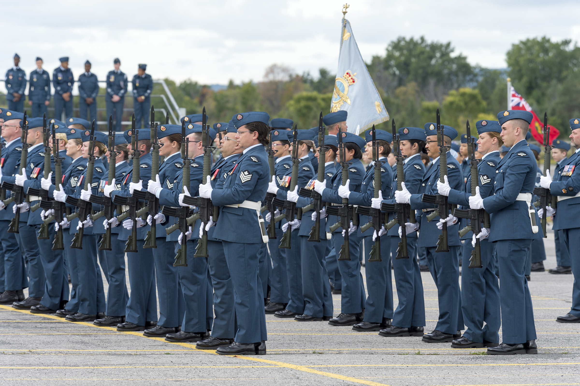RCAF personnel present arms (which is a salute with rifles) during the national Battle of Britain parade held September 15, 2019, at the Canada Aviation and Space Museum in Ottawa, Ontario. PHOTO: Aviator Jacob Hanlon, FA01-2019-0008-025