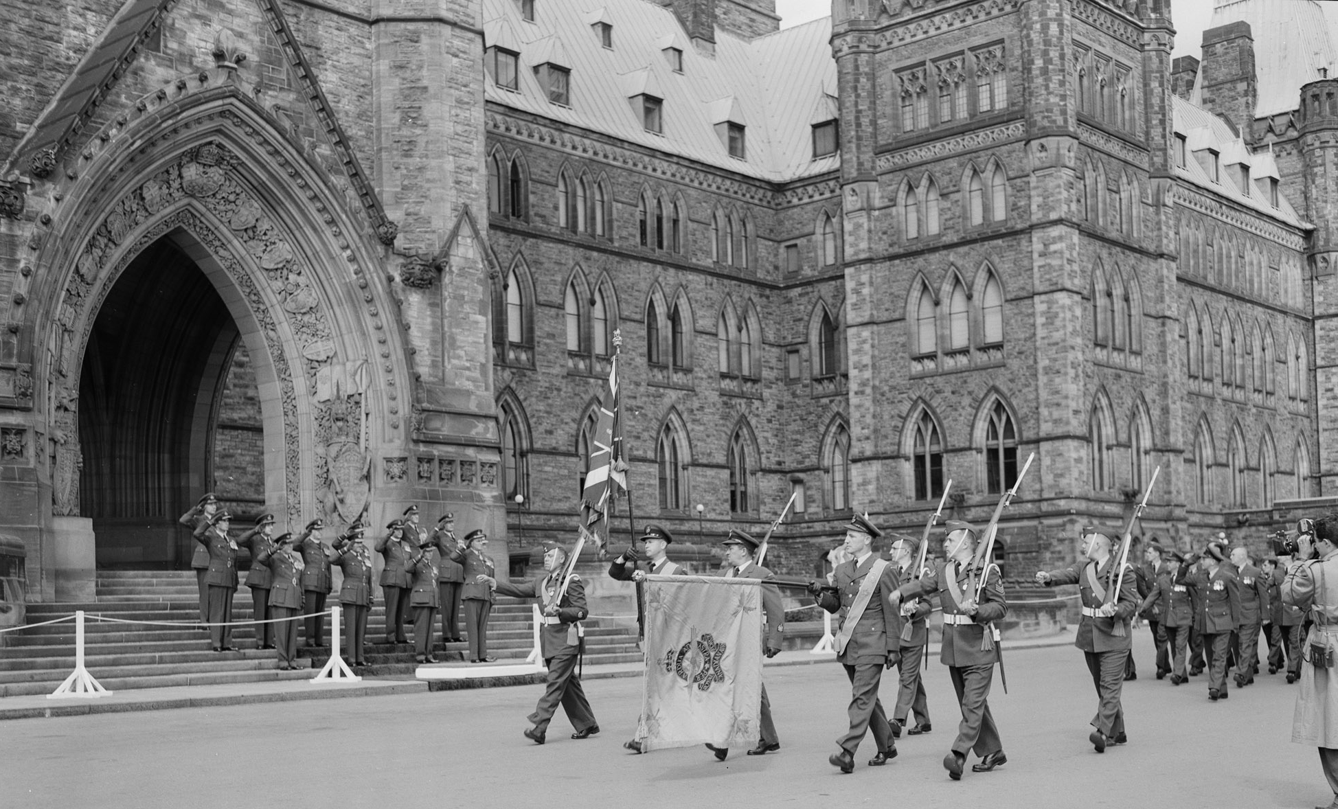 During the Battle of Britain parade held on Parliament Hill on September 16, 1956, the colour party marches past the saluting base in front of the Peace Tower.