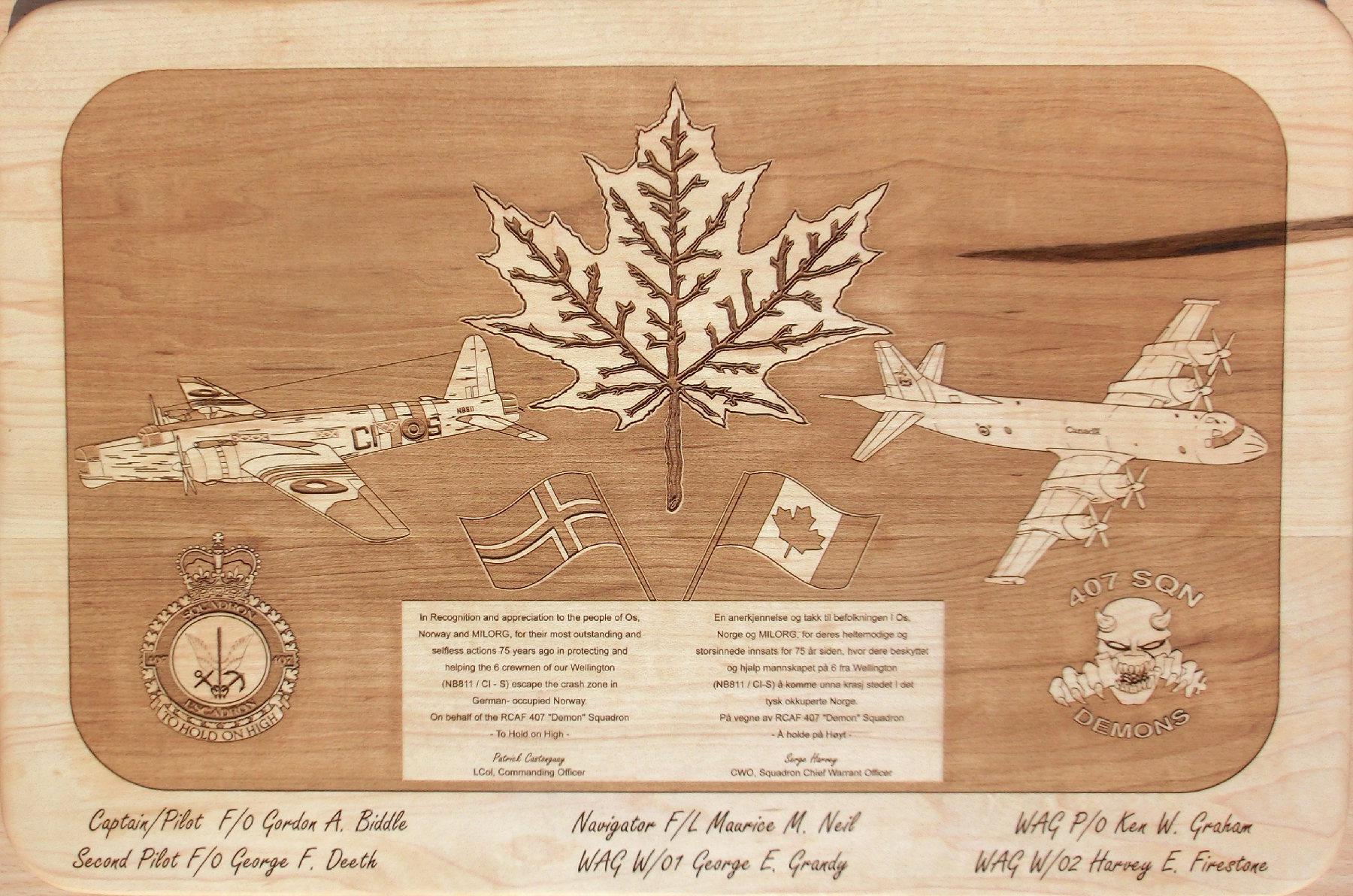 "An etched wooden plaque commemorating the events of early autumn 1944 in Os, Norway, reads: ""In Recognition and appreciation to the people of Os, Norway, and MILORG, for their most outstanding and selfless actions 75 years ago in protecting and helping the 6 crewmen of our Wellington (NB811 / CI - S) escape the crash zone in German- occupied Norway. On behalf of the RCAF ""Demon"" Squadron - To Hold On High – Patrick Castonguay LCol, Commanding Officer"".  Etched at the bottom are the names of the six crewmembers: Captain/Pilot F/O Gordon A. Biddle; Second Pilot F/O George F. Deeth; Navigator F/L Maurice M. Neil; WAG W/01 George E. Grandy; WAG PO Ken W. Graham; W/02 Harvey E. Firestone. PHOTO: Submitted"