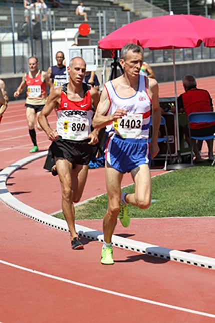 "CF Running Chief Official Chief Warrant Officer Claude Faucher (bib 890) competes in the 1500m at World Masters Athletics Championships 2015 in Lyon, France. PHOTO: Doug ""Shaggy"" Smith"