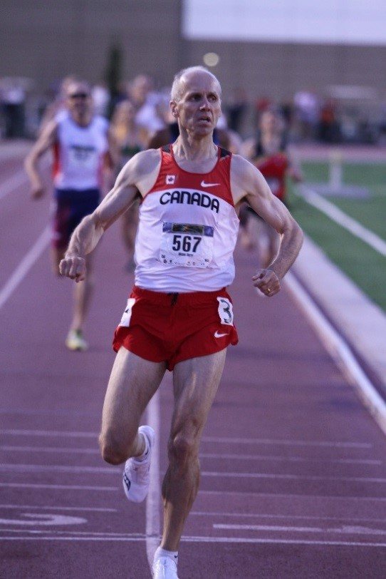 "Michael Sherar (bib 567), from Toronto, captures gold in the M45 800m at the World Masters Athletics Championships in Sacramento, California, in 2011. PHOTO: Doug ""Shaggy"" Smith"