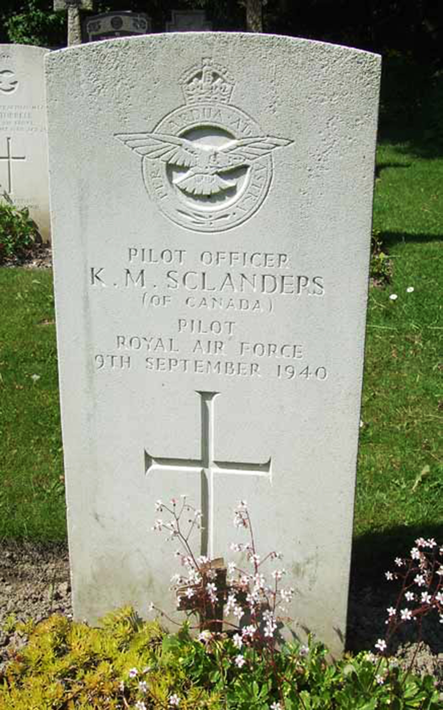 "The grave of Pilot Officer Kirkpatrick MacLure Sclanders, maintained through the Commonwealth War Graves Commission, is in the ""Airman's Corner"" in St. Luke's Churchyard, Whyteleafe, Surrey, England. PHOTO: Battle of Britain London Monument"